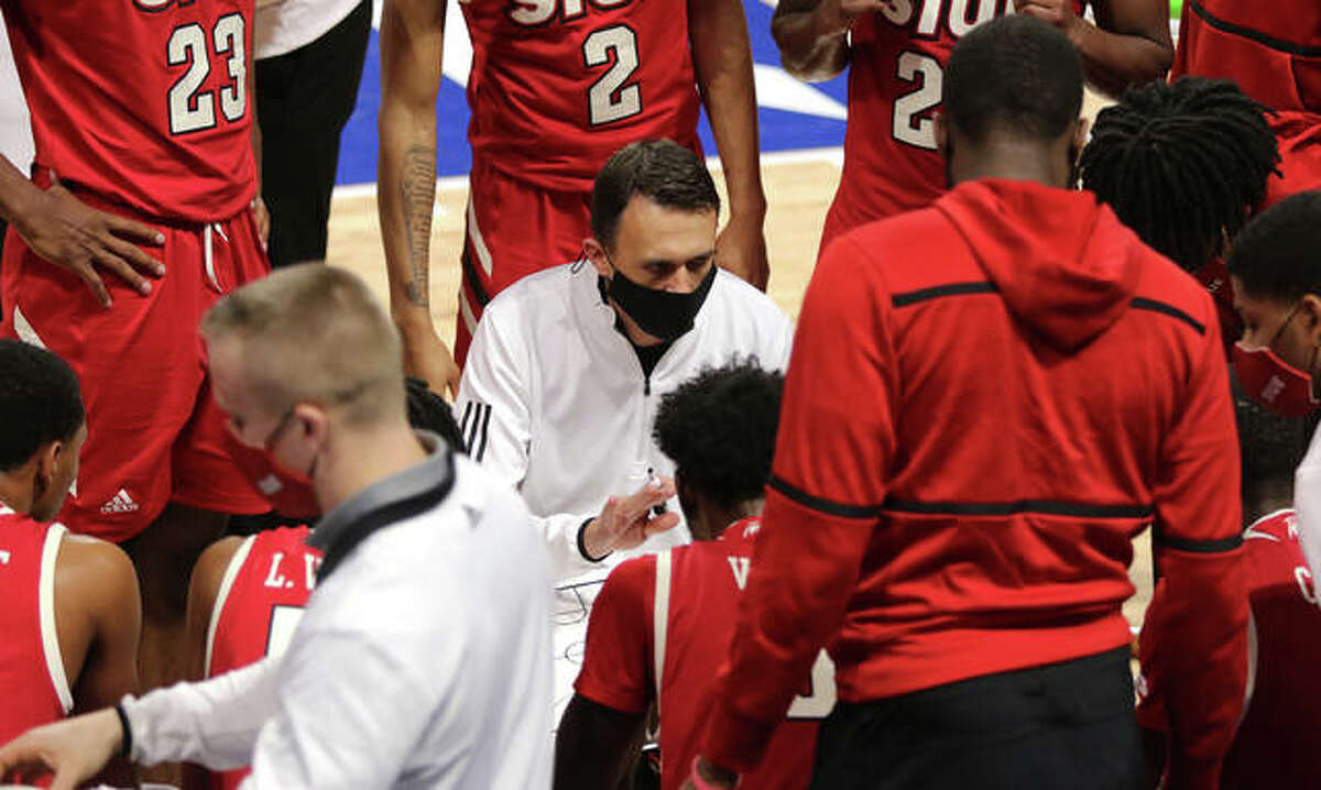 SIUE men's basketball coach Brian Barone talks to his team during a timeout last season in the opener against Saint Louis University.