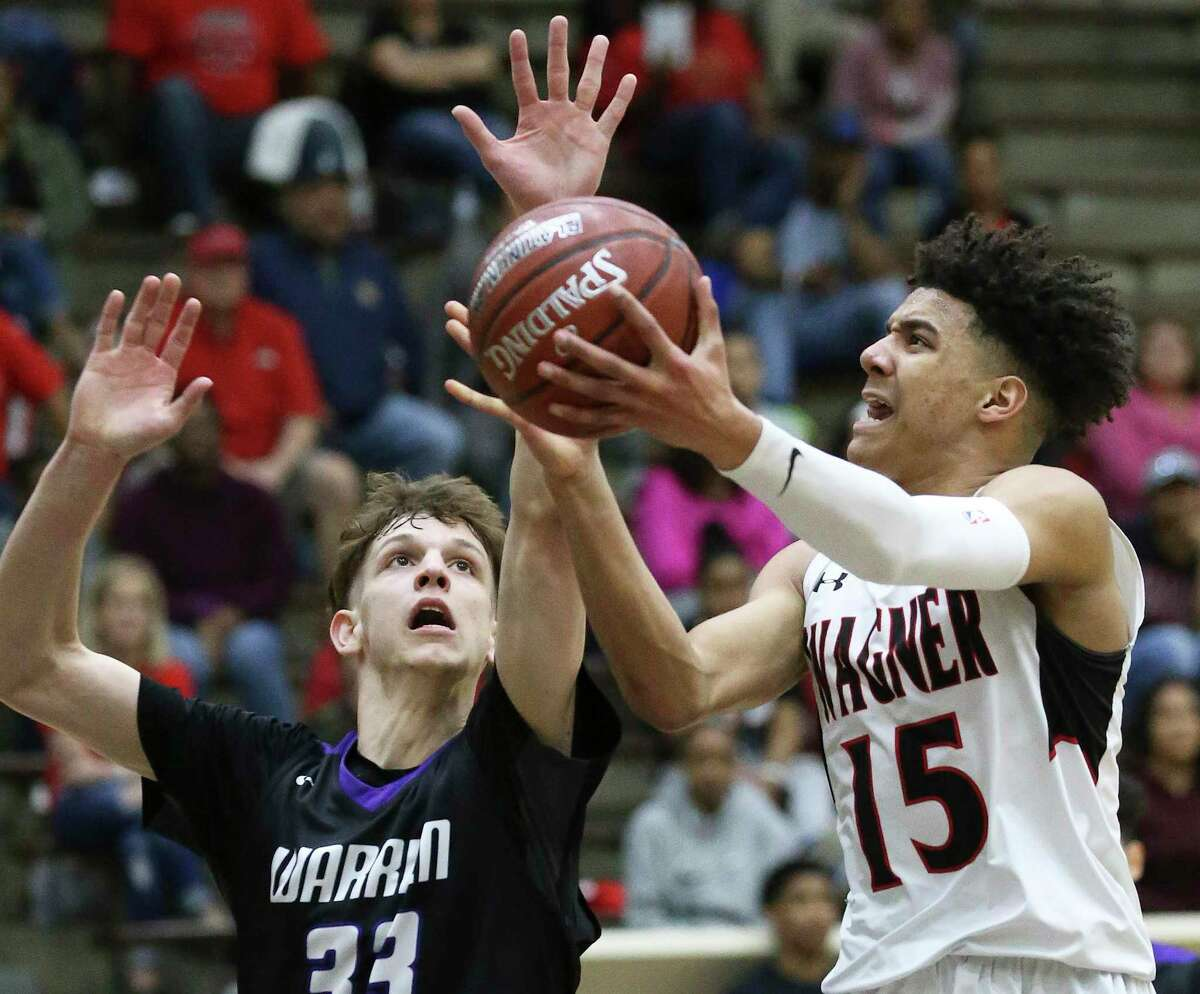 Kevin McCullar gets a shot offf for the T-Birds against Adrian McConnell as Wagner plays Warren in bidistrict basketball action at the Alamo Convocation Center on February 20, 2018.
