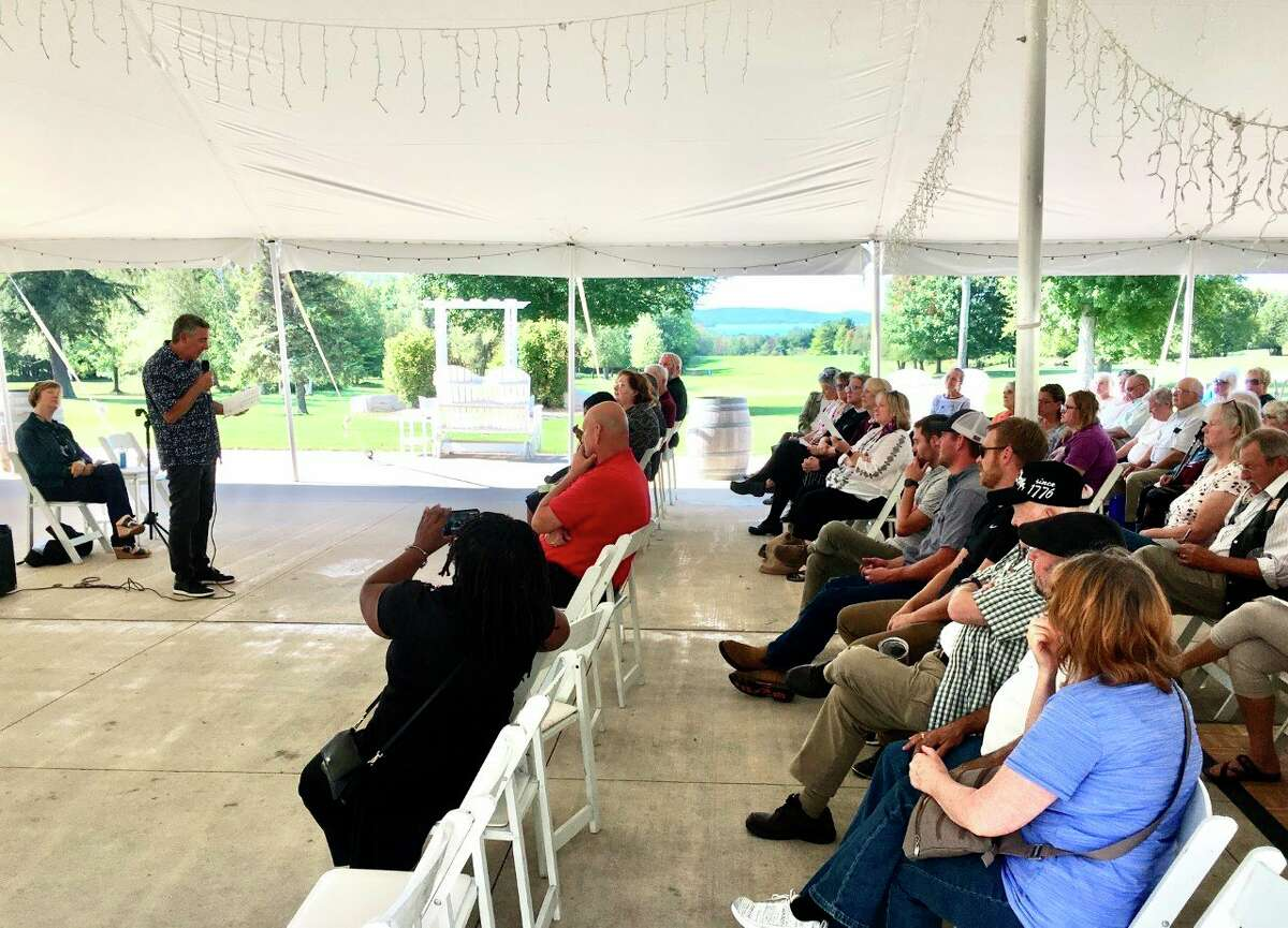 Pastor Chuck Towersey speaks to around 180 people on Sept. 19 at the celebration for the creation of Benzie Faith in Action, a nonprofit organization of area churches and people of faith looking to tackle housing issues and internet availability. (Courtesy Photo)