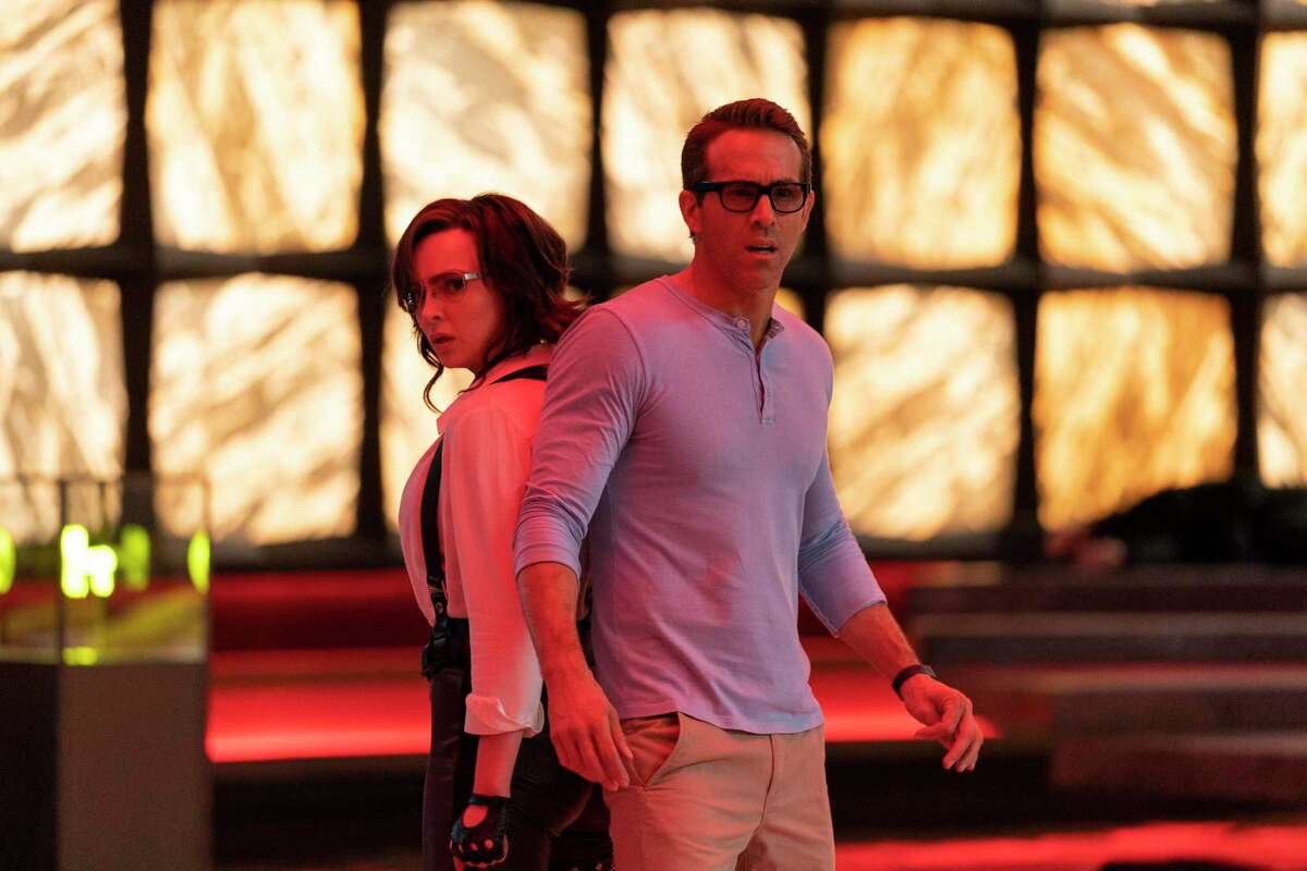 """Jodie Comer (left) and Ryan Reynolds star in """"Free Guy."""""""