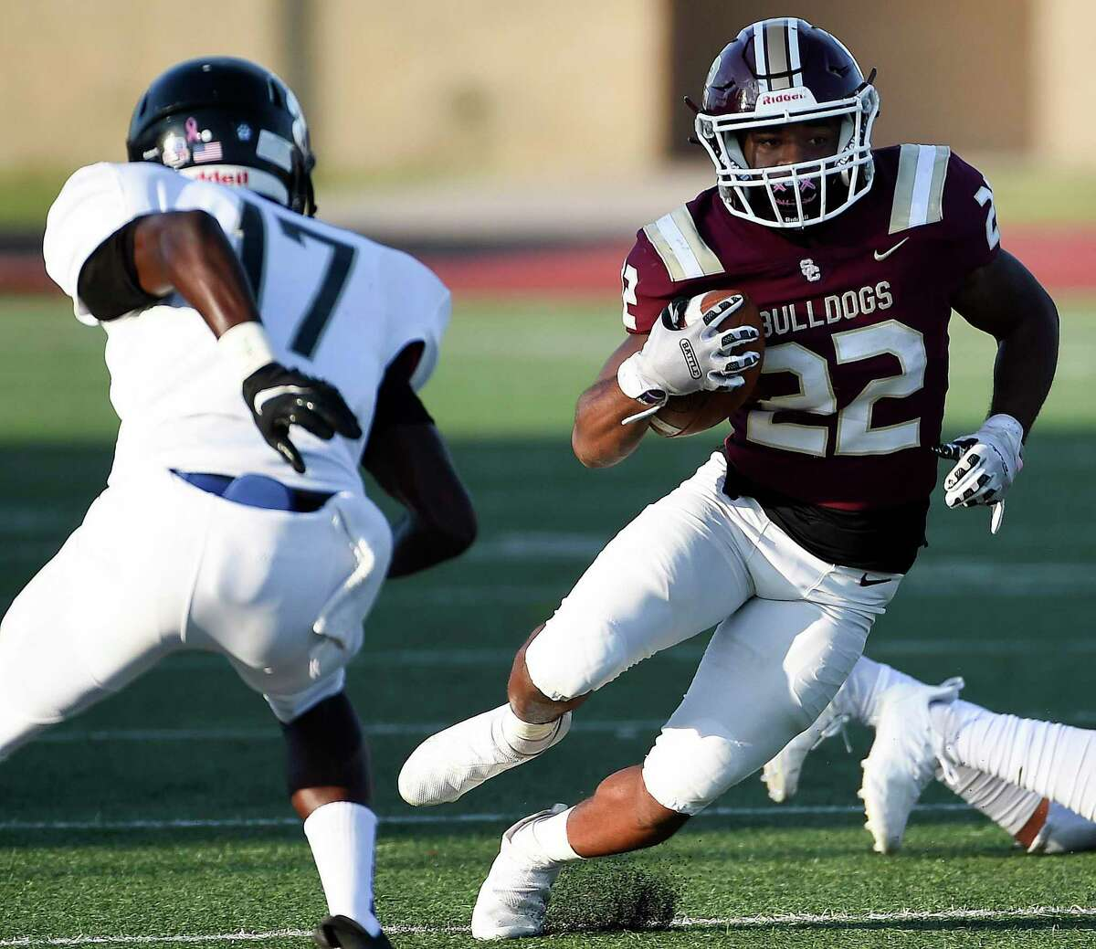 Summer Creek running back Torrie Curry (22) rushes past Westside defensive back Divine Afuke (17) during the first half of a high school football game, Saturday, Sept. 18, 2021, in Humble.
