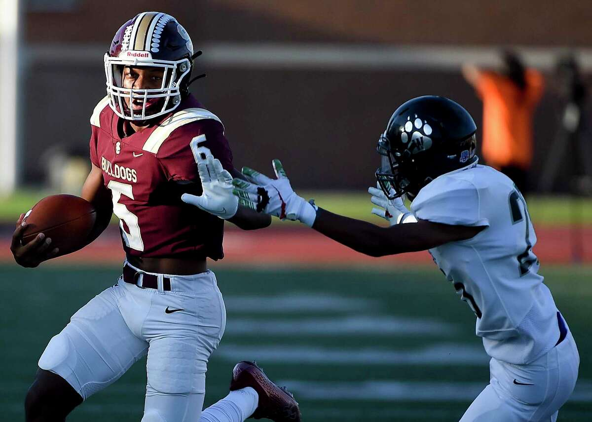 Summer Creek quarterback Cory Nichols (6) rushes past Westside defensive back Anthony Willis during the first half of a high school football game, Saturday, Sept. 18, 2021, in Humble.