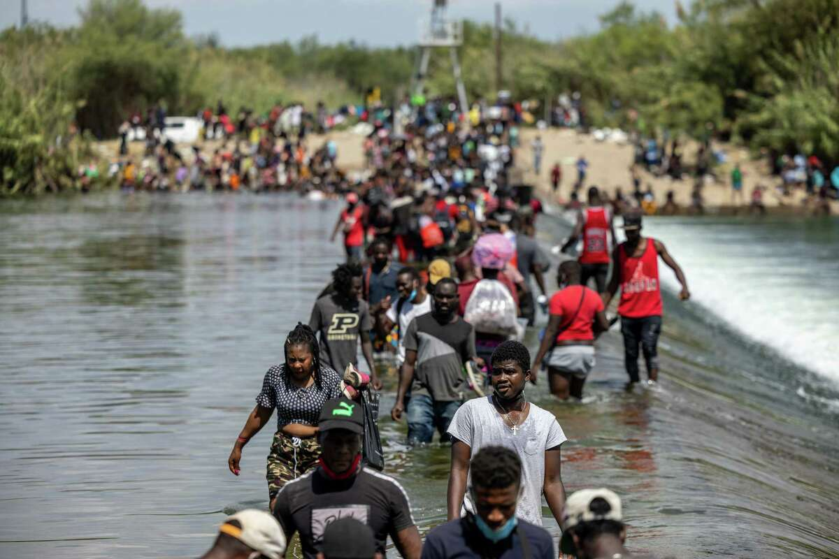Migrants cross the Rio Grande earlier this month in Del Rio. By sending thousands of Haitians back to their country of origin, the Biden administration ran counter to asylum law. These asylum-seekers deserved their day in court.
