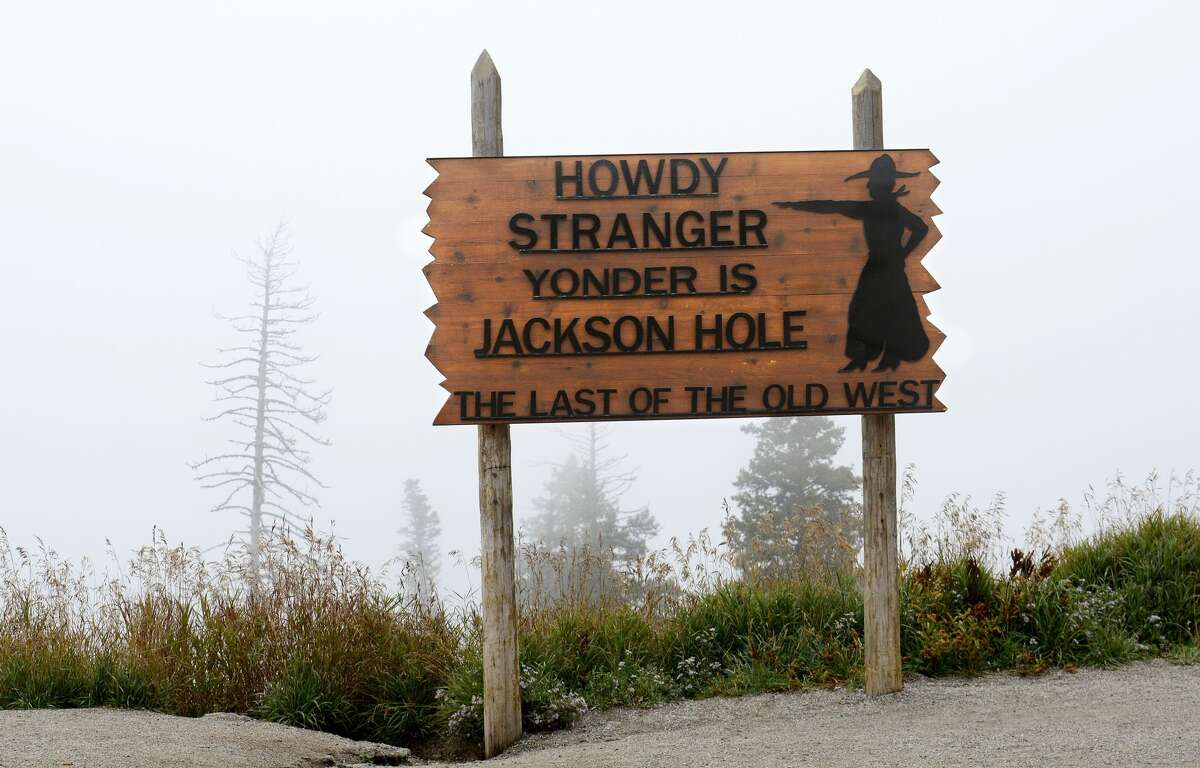 JACKSON HOLE, WY - SEPTEMBER 23, 2014: A sign at the summit of Teton Pass west of Jackson Hole, Wyoming, invites motorists to to stop and enjoy the view of Jackson Hole in the valley below, unfortunately not visible on foggy days. (Photo by Robert Alexander/Getty Images)