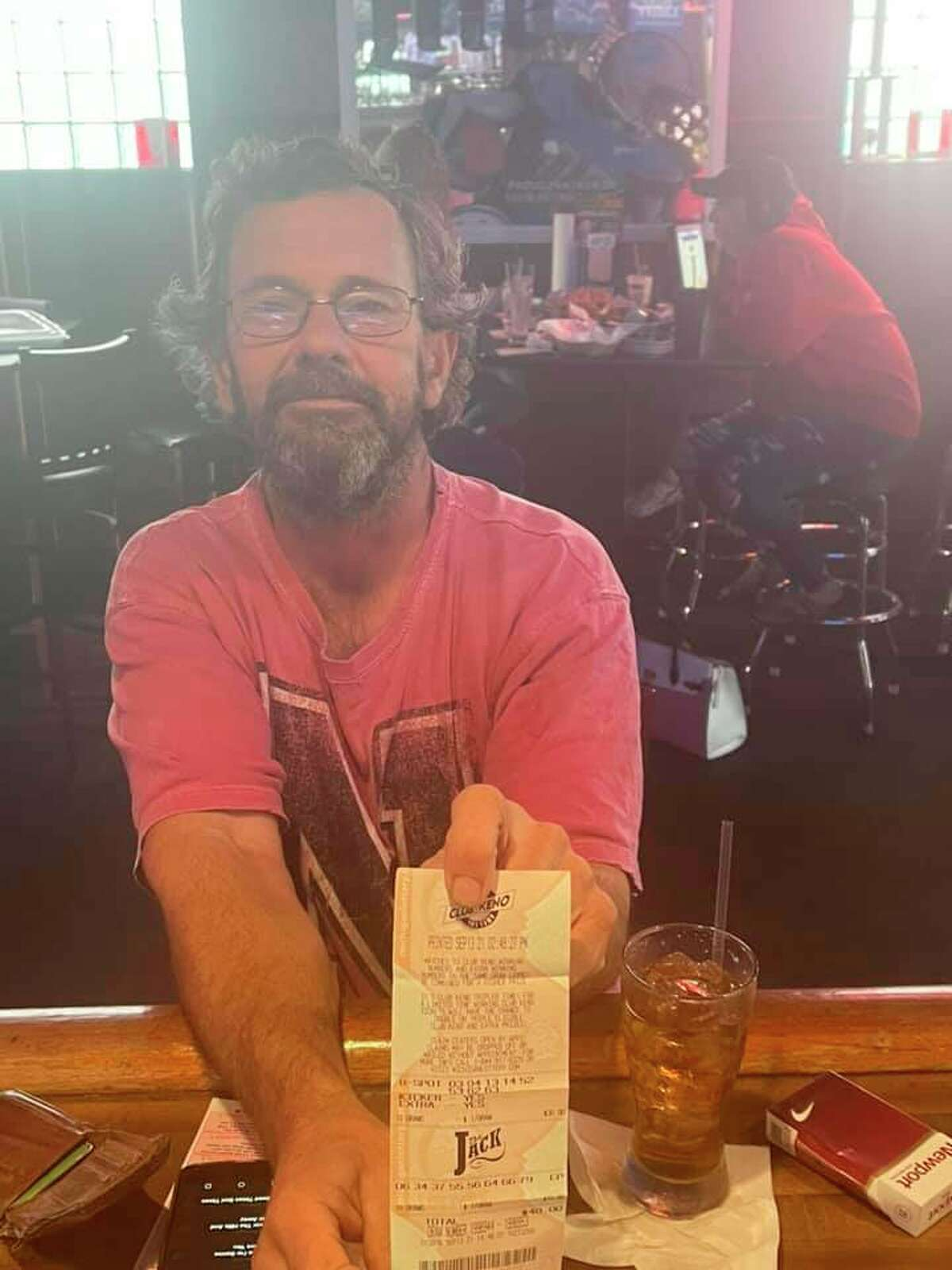 Gregory Jarvis shows off his winning lottery ticket. (Courtesy Photo via Facebook)