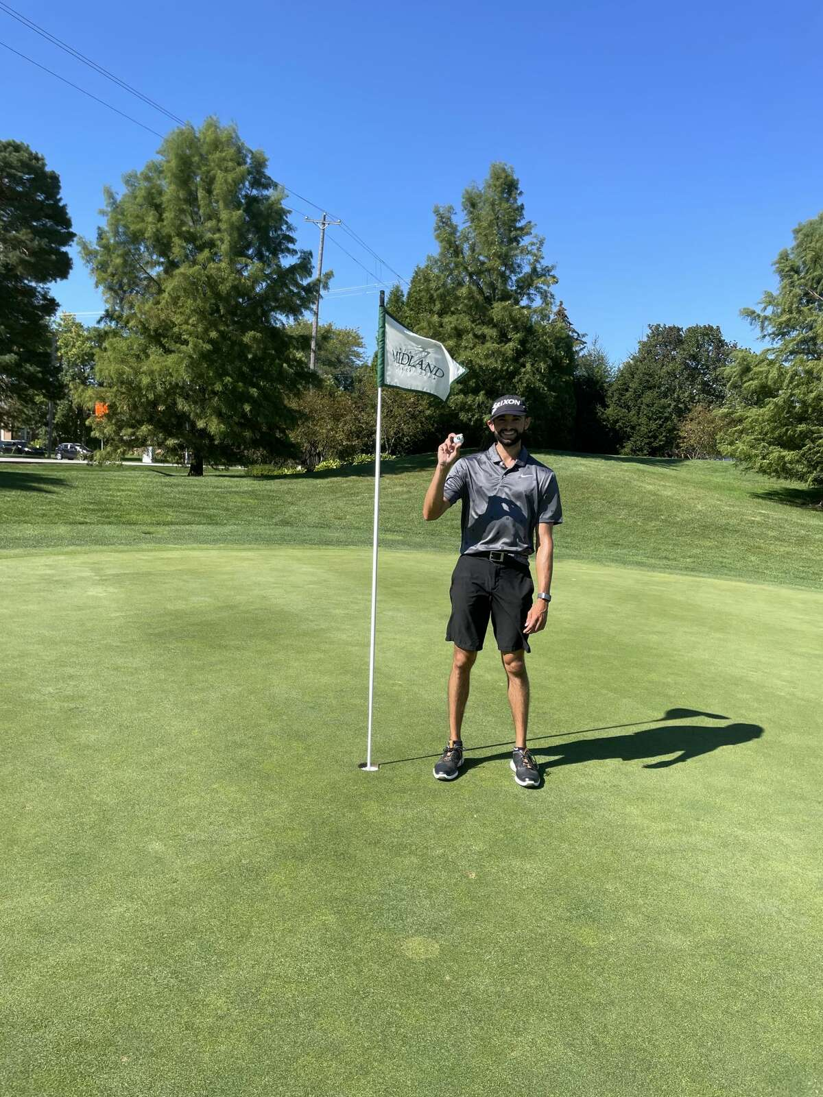 Midland native Cam Lippoldt poses with his hole-in-one golf ball after making an improbable ace on the par-4 fifth hole at Midland Country Club on Sept. 17 (Photo provided).