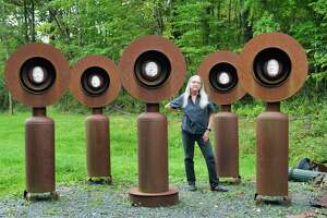 """Artist Mary Pat Wager with her sculpture titled """"Monuments"""" at her studio on Tuesday, Sept. 28, 2021, in East Greenbush, N.Y."""