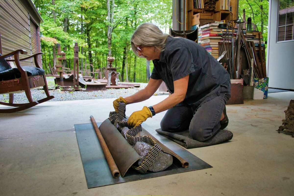 Artist Mary Pat Wager works on one of her pieces in her studio on Tuesday, September 28, 2021 in East Greenbush, NY