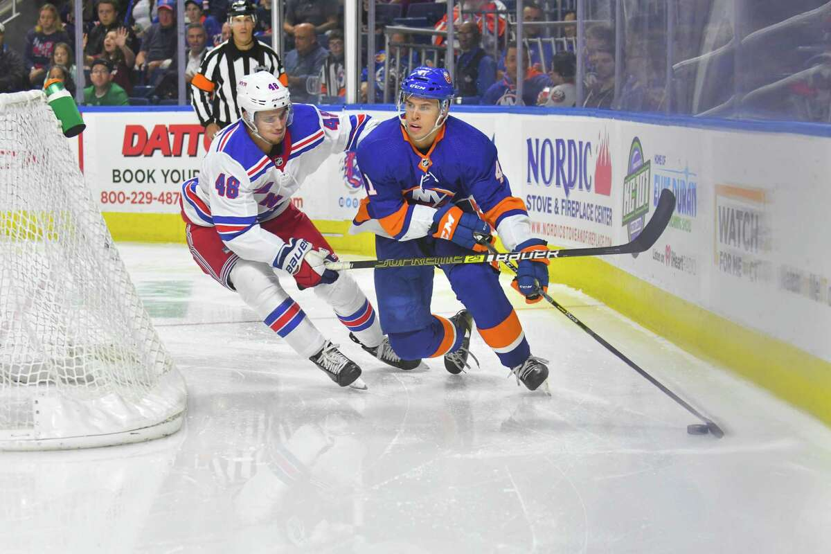 Parker Wotherspoon (41) of the New York Islanders is defended behind the net by Brett Howden (48) of the New York Rangers during a pre-season game played on September 22, 2018 at Webster Bank Arena in Bridgeport, Connecticut.