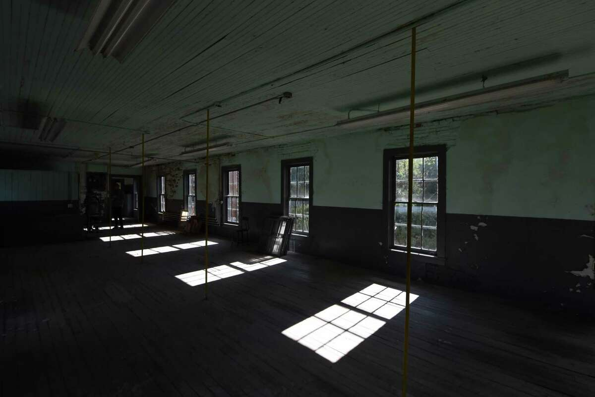 Inside floor space at the former garment factory being renovated by Jon and Deana Ketchum, who own a furniture making company and are turning the space into a production facility and living space on Wednesday, Sept. 29, 2021, in Salem, N.Y.