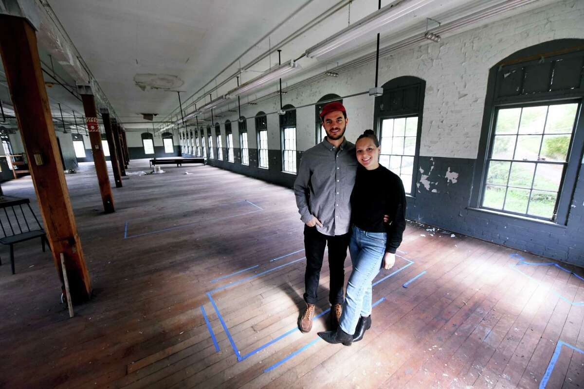 Jon and Deana Ketchum, who are converting a former garment factory into a production facility and living space for their woodworking furniture company on Wednesday, Sept. 29, 2021, in Salem, N.Y.