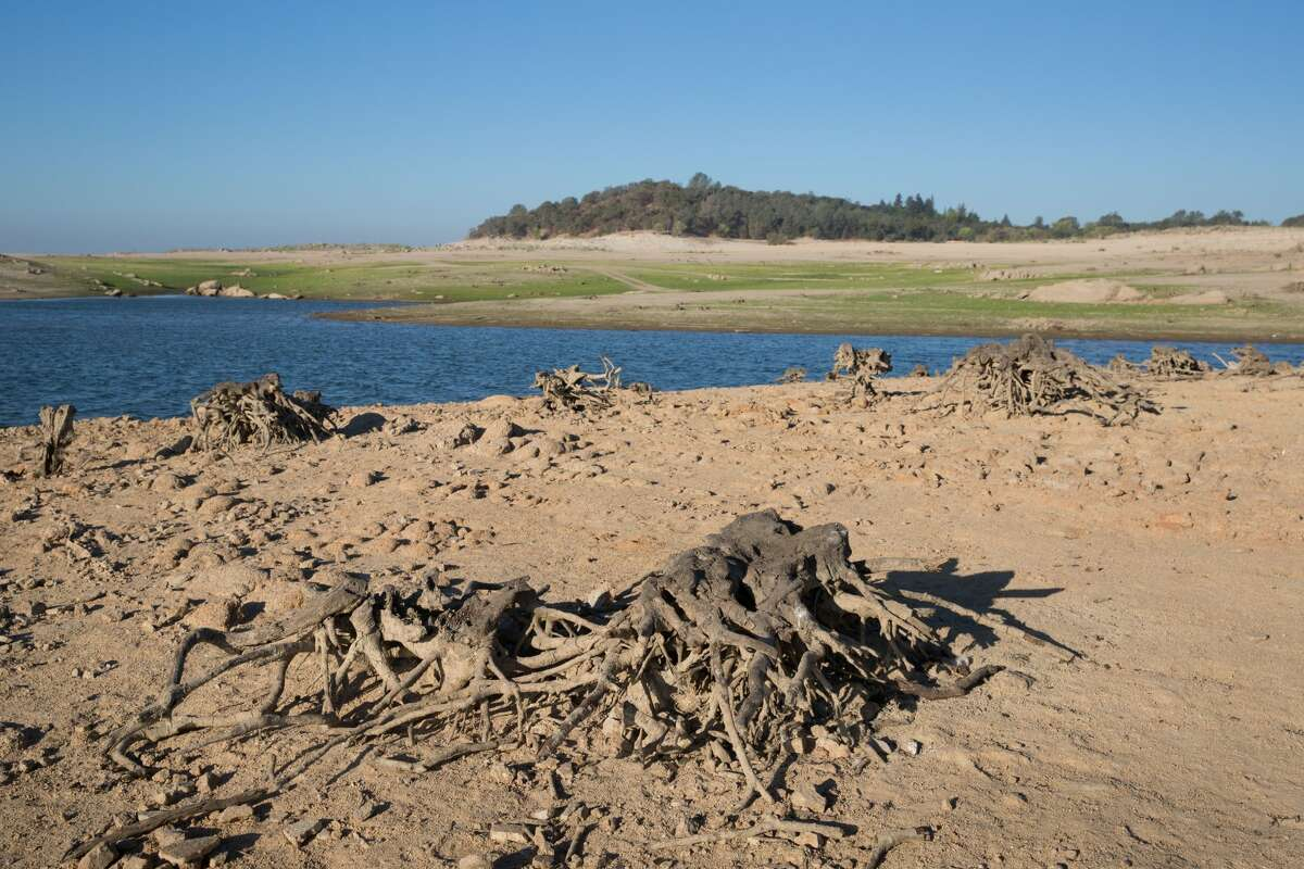 Folsom Lake, one of the state's larger water reservoirs fed by the three forks of the American River, was at 24% capacity on Aug. 13, 2021, and is at historically low levels, impacting hydroelectric power, tourism and agriculture.