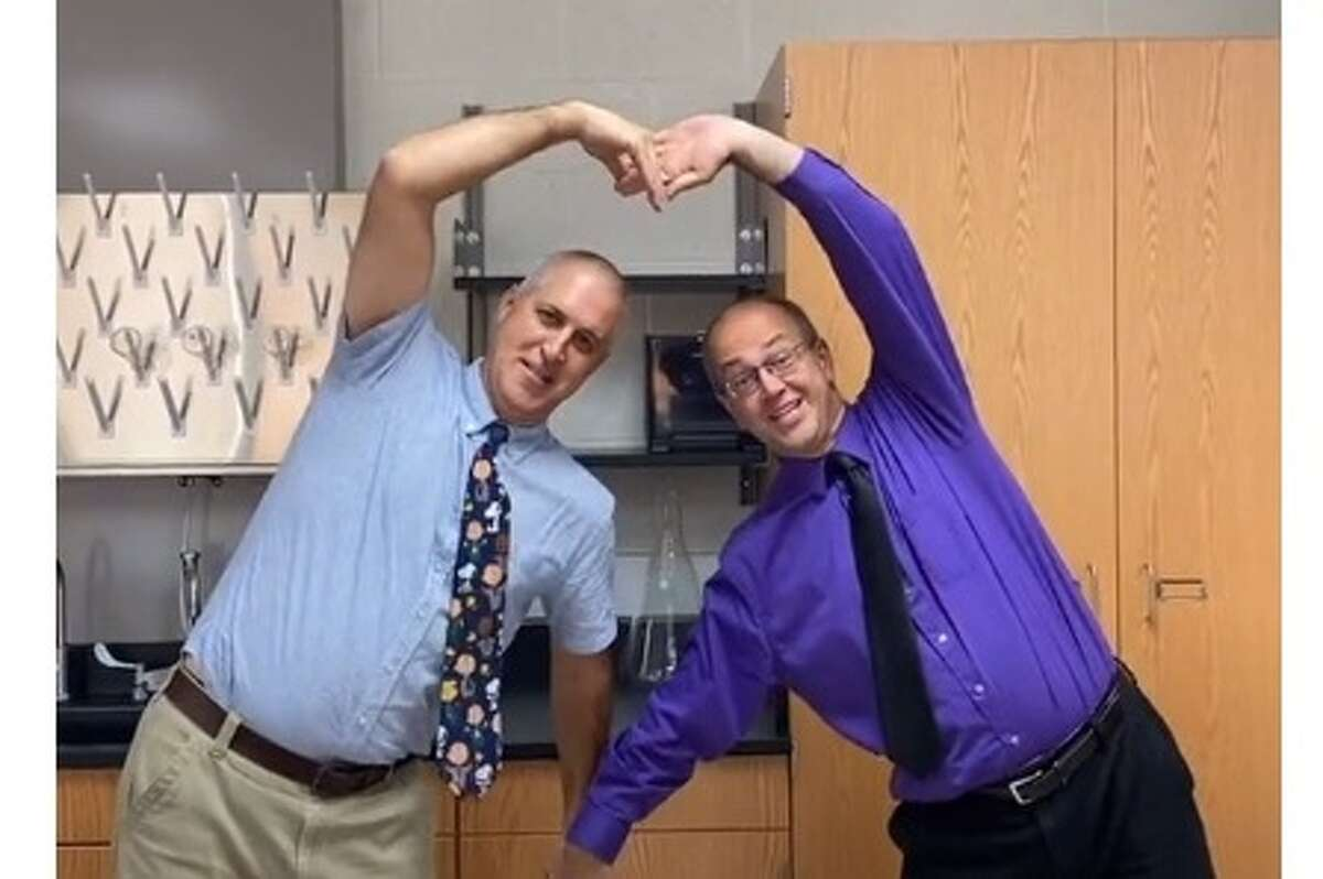 Midland High School science teachers Brian Edelbrock, left, and Jeff Yoder are shown in a screenshot from the TikTok video that they recently made at the encouragement of two of their students, which has gotten more than 12,000 views.