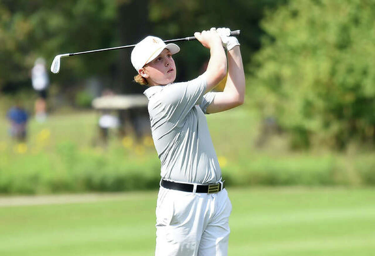 Edwardsville's Mason Lewis watches his second shot on No. 11 at Arlington Greens Golf Course during the Class 3A Collinsville Regional on Wednesday in Granite City.