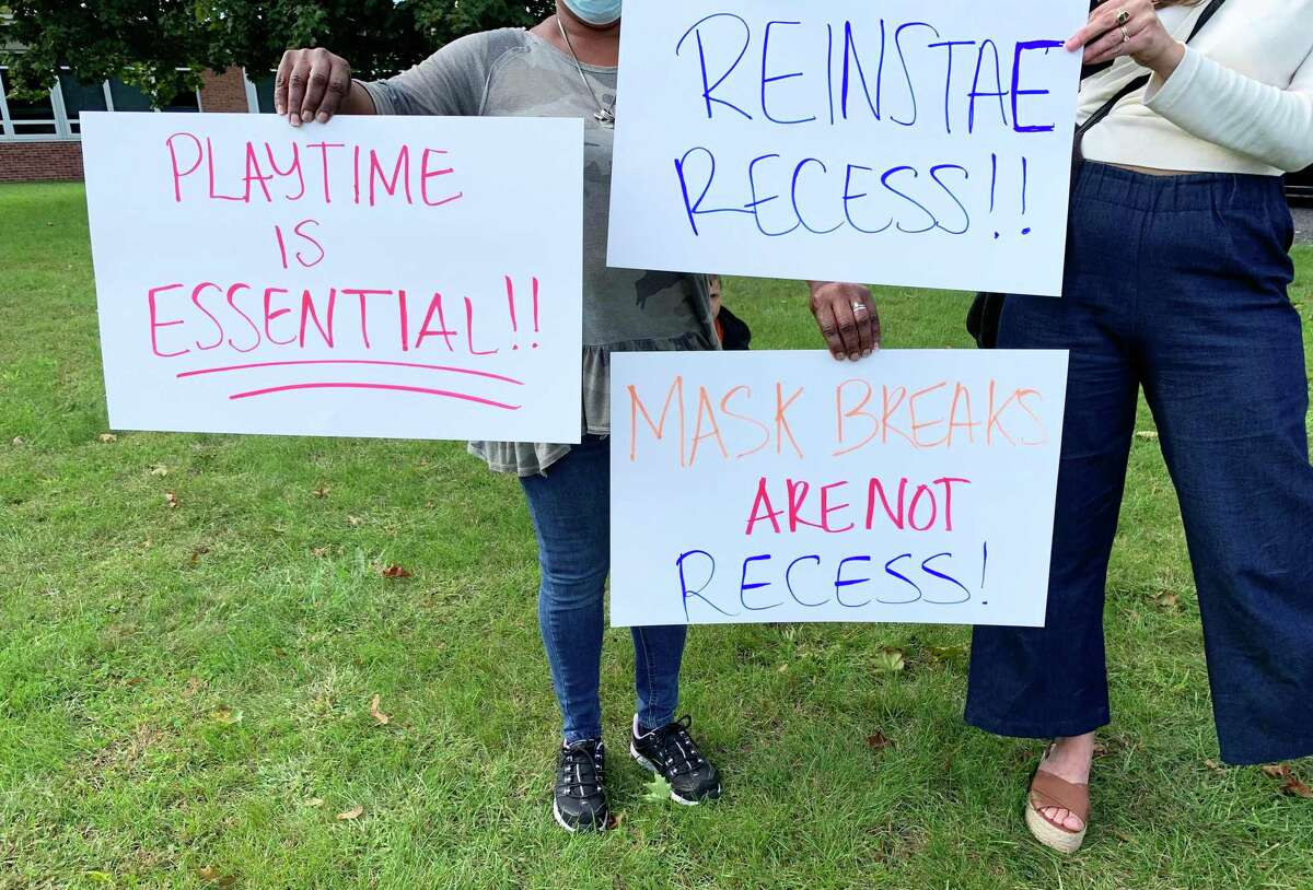 Shown are some of the signs that peaceful protesters displayed Wednesday in front of the Middletown Board of Education building.
