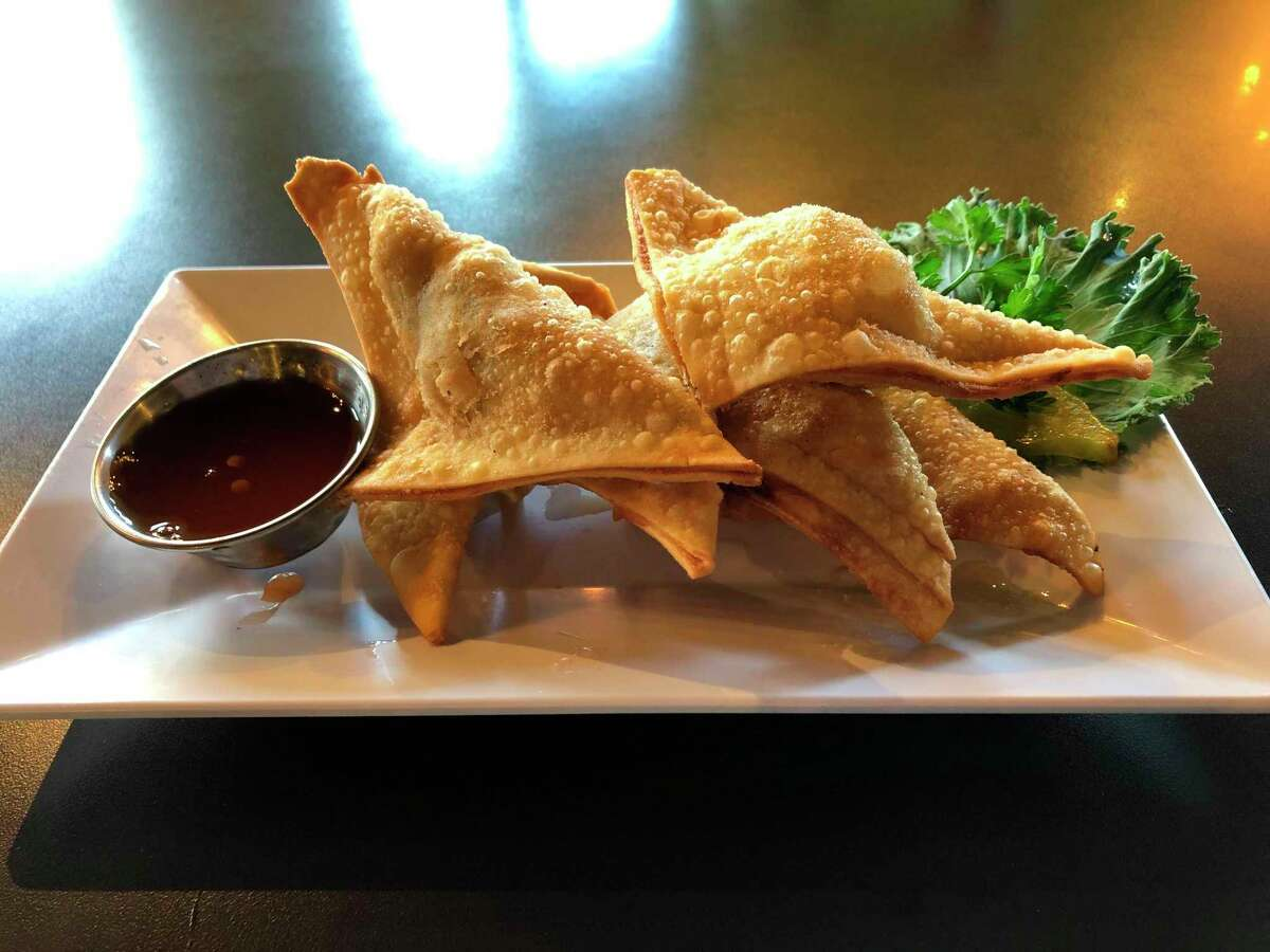 Basil Thai Bistro's golden triangles came out hot and fresh, five piled on a plate, accompanied by sweet and sour sauce. (Victoria Ritter/vritter@mdn.net)