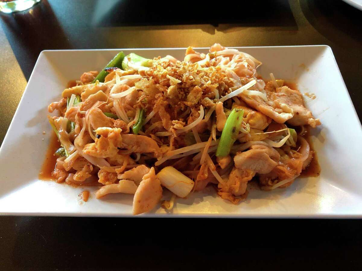 Basil Thai Bistro's pad thai includes rice noodles soaked with a red sauce, chicken, egg, green onions and bean sprouts, all topped with ground peanuts. (Victoria Ritter/vritter@mdn.net)