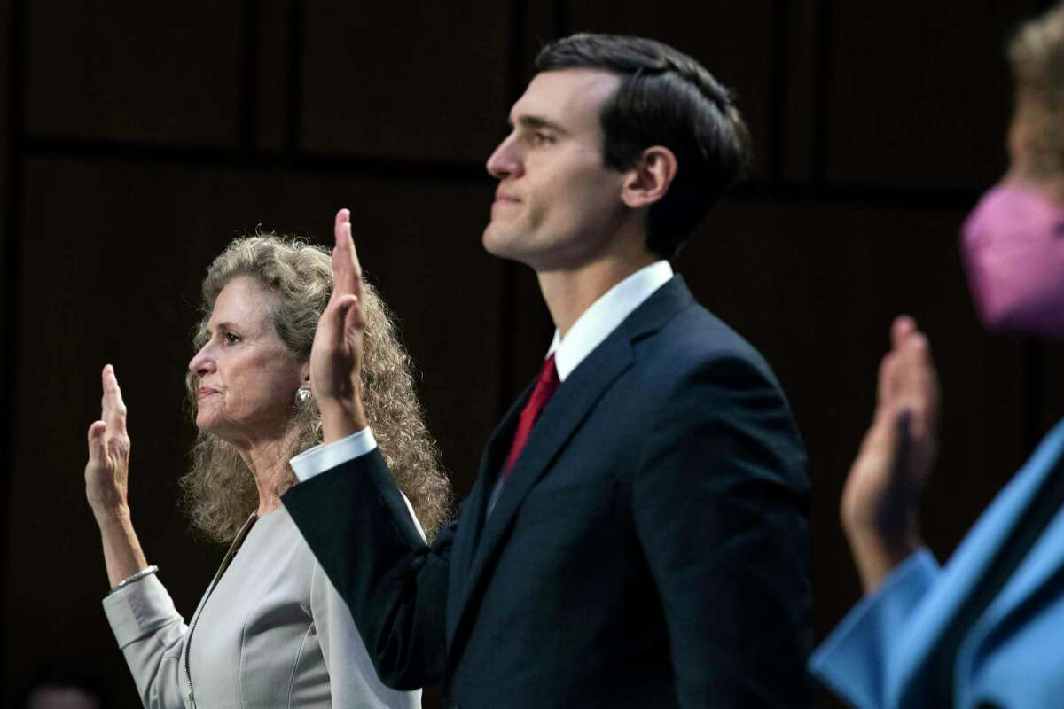From left, Texas State Rep. Donna Howard, District 48, Edmund Gerard LaCour Jr., Alabama solicitor general, and Fatima Goss Graves, president and CEO of the National Women's Law Center, are sworn in during a Senate Judiciary Committee hearing to examine Texas's abortion law, Wednesday, Sept. 29, 2021 on Capitol Hill in Washington. (Tom Williams/Pool via AP)