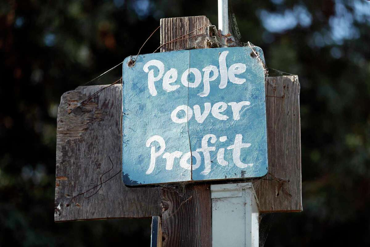 """A sign at People's Park in Berkeley advocates """"People over Profit."""" The UC regents, who own the park, are expected to approve a housing project this week for students and the indigent people who have gathered there for generations. Opponents say the park's legacy should be preserved."""