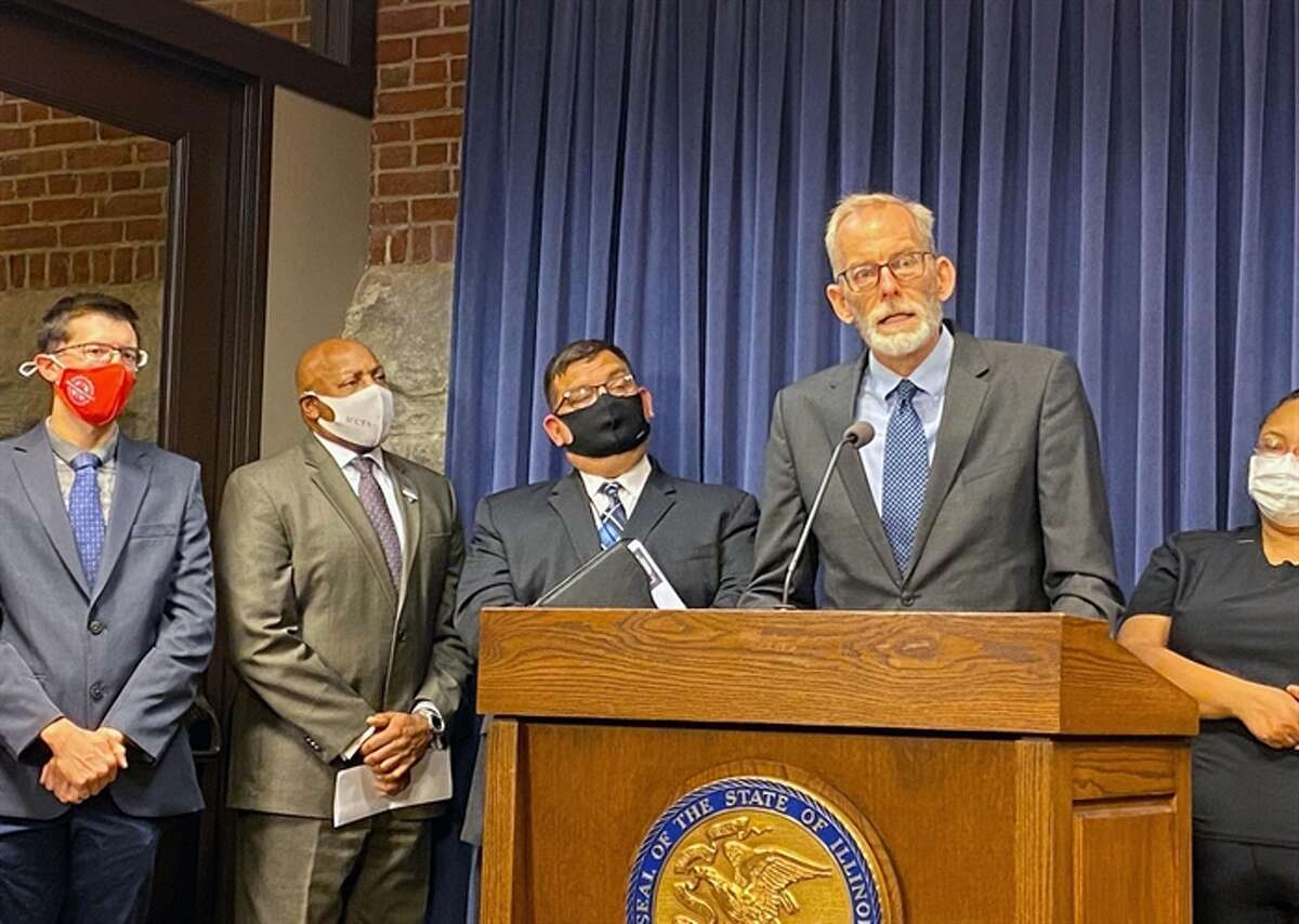 Brian Richard of the Northern Illinois University Center for Governmental Studies, speaks at a news conference. He is author of a report showing the economic impact of community colleges.