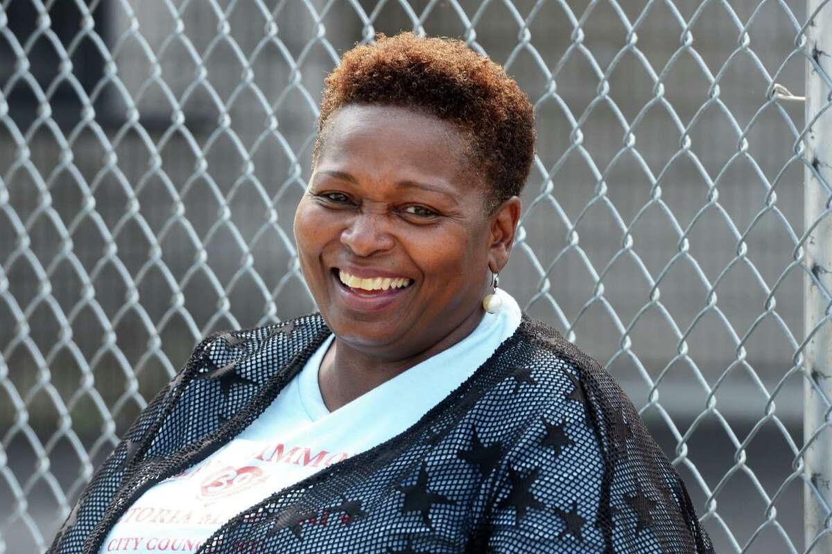 Candidate Wanda Simmons poses outside Dunbar School, in Bridgeport, Conn. Sept. 14, 2021.
