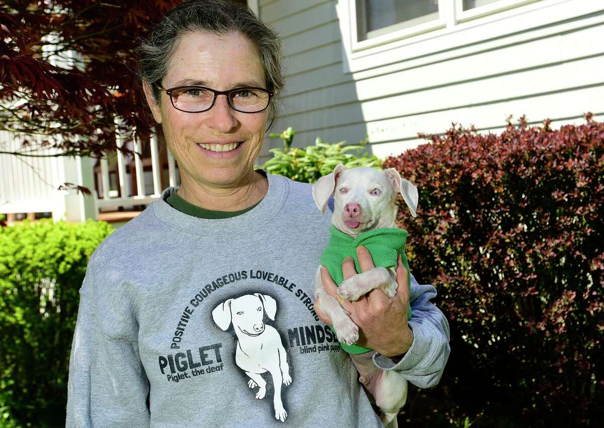 Veterinarian Melissa Shapiro and her dog Piglet at their home April 23, 2021, in Westport, Conn.