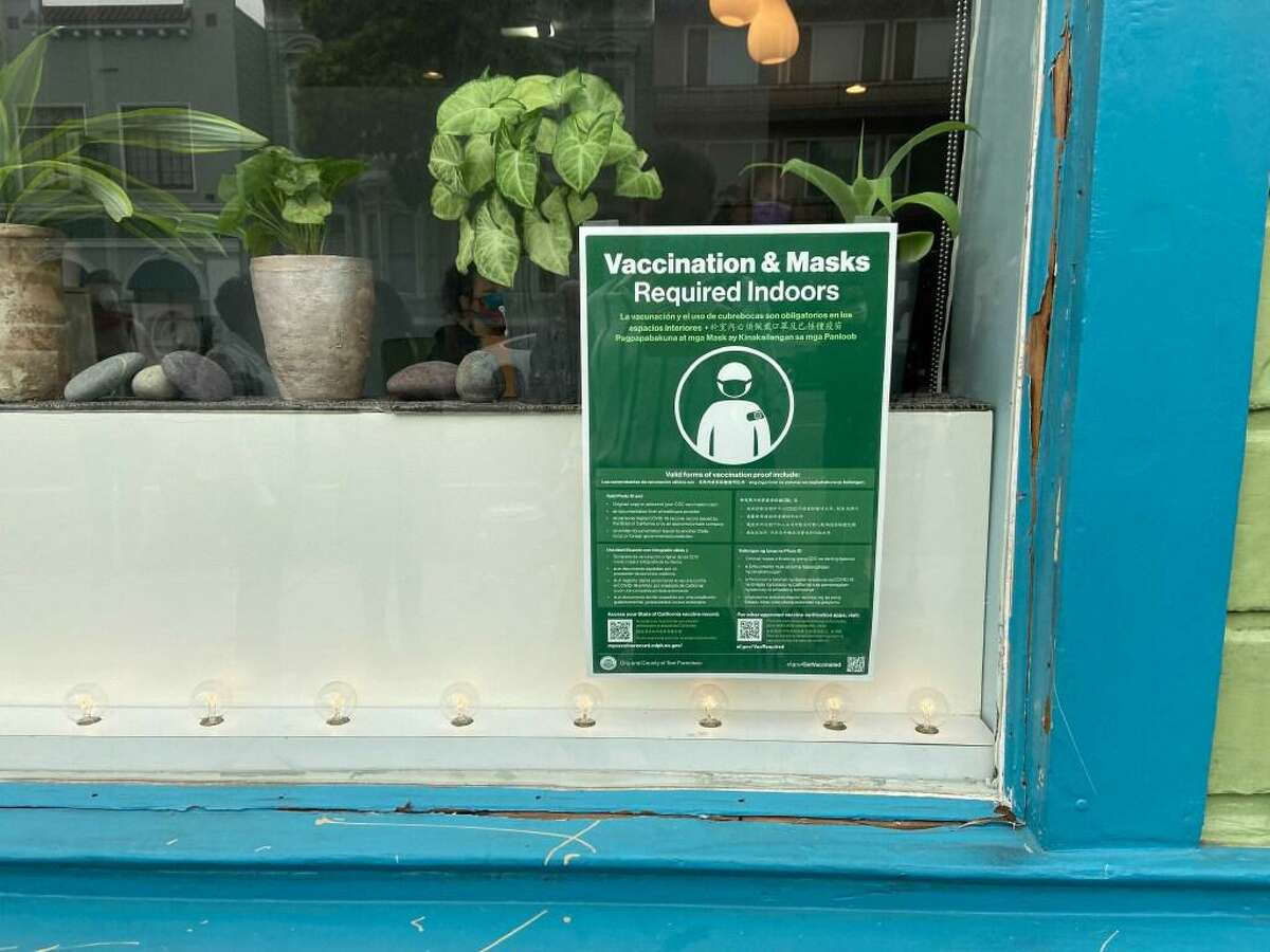 A sign on a business in San Francisco signals that vaccines are require on Friday, Aug. 20, 2021, in San Francisco, Calif.