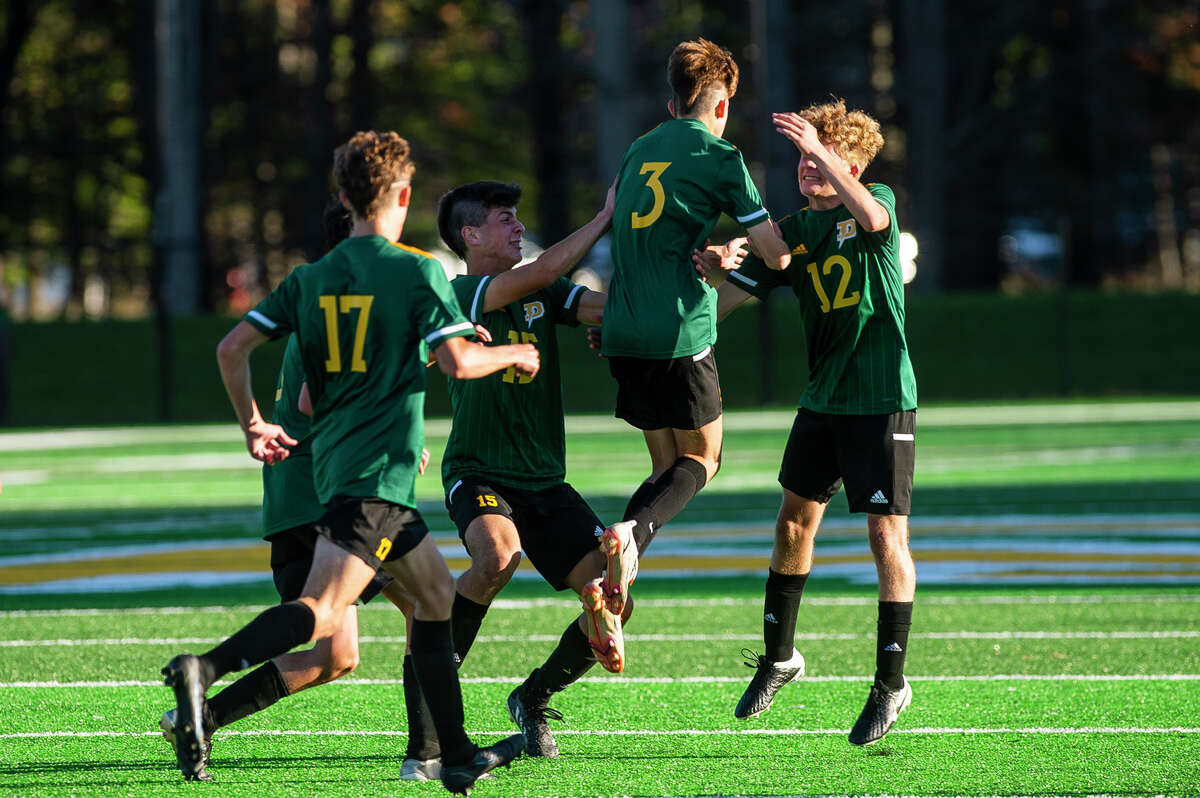 Dow players celebrate after Jonah Dahn's second goal during the Chargers' game against Midland Wednesday, Sept. 29, 2021 at H. H. Dow High School. (Katy Kildee/kkildee@mdn.net)