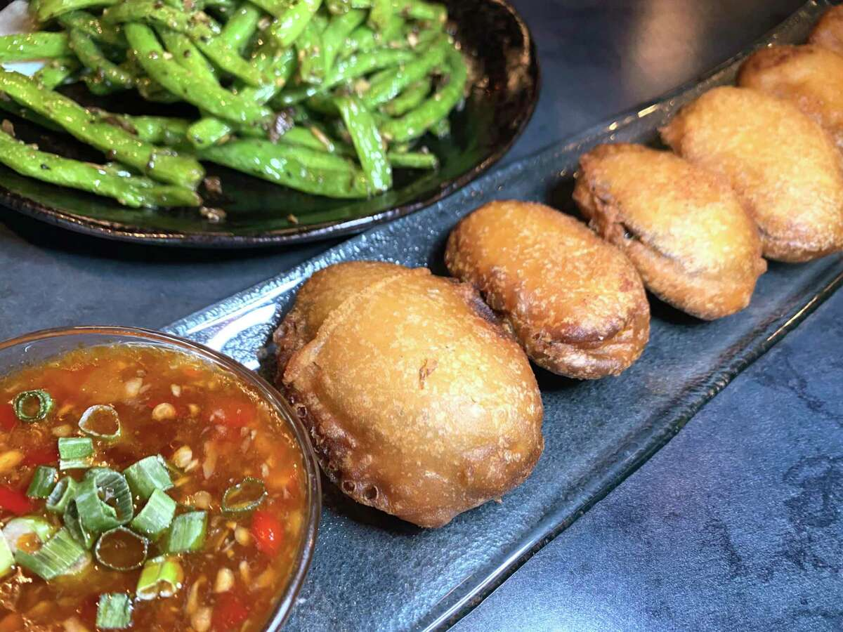 The menu includes eggplant fritters, foreground, and wok-seared green beans at Dashi Sichuan Kitchen + Bar, a new Chinese restaurant from the owner of Sichuan House.