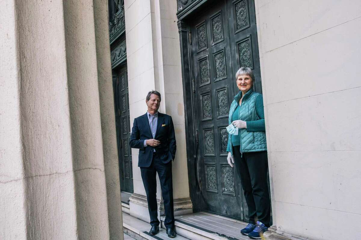 Richard Hannum, founder of Forge Development Partners, left, and Ela Strong, president of the executive board at Fifth Church of Christ, Scientist, stand for a portrait together in San Francisco, in February. The church, in partnership with Forge, is looking to develop its nearly century-old and underutilized historical building into a 13-story mixed-use facility.