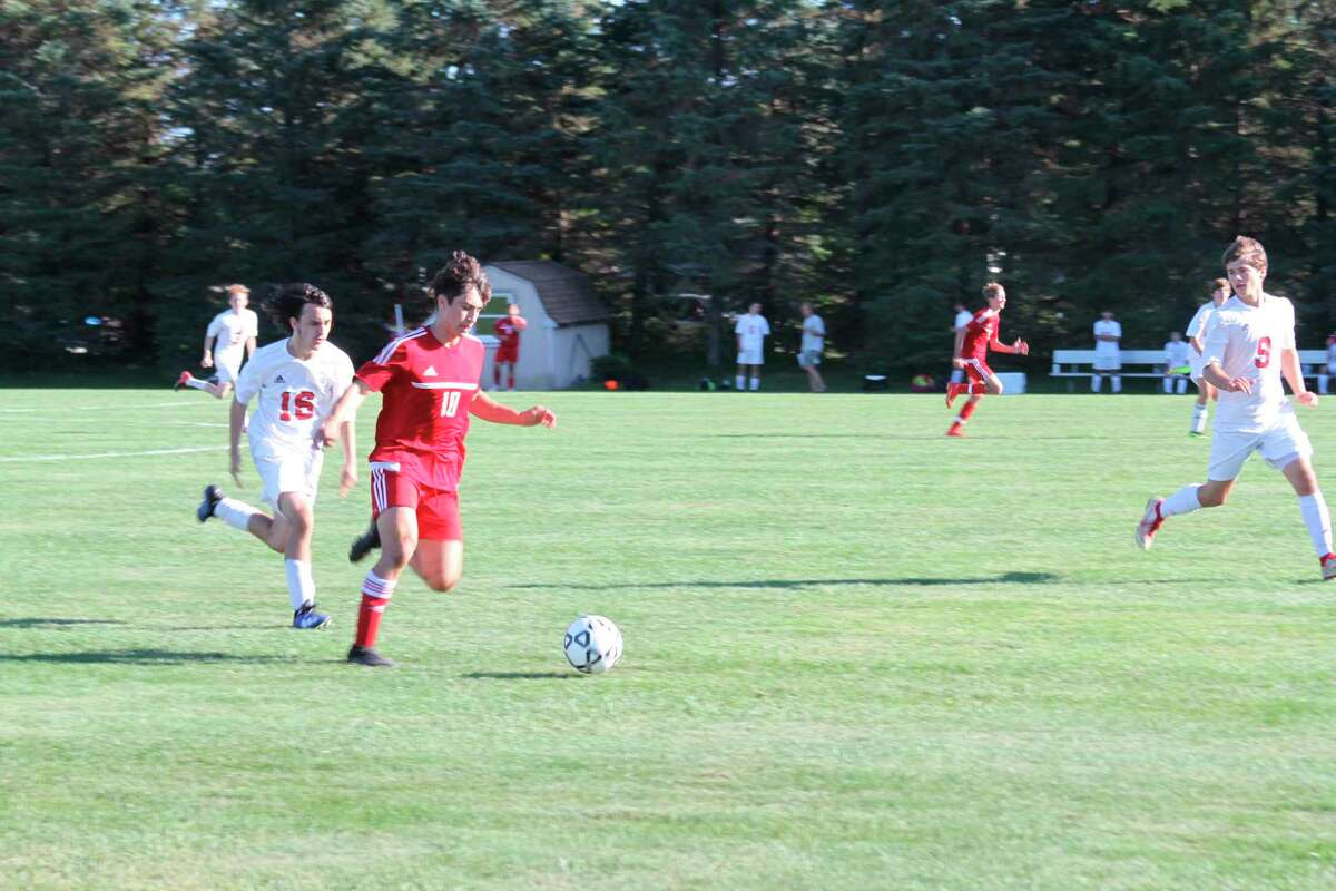 Benzie Central's Kevin Hubbell races towards the goal against Suttons Bay. (McLain Moberg/News Advocate)