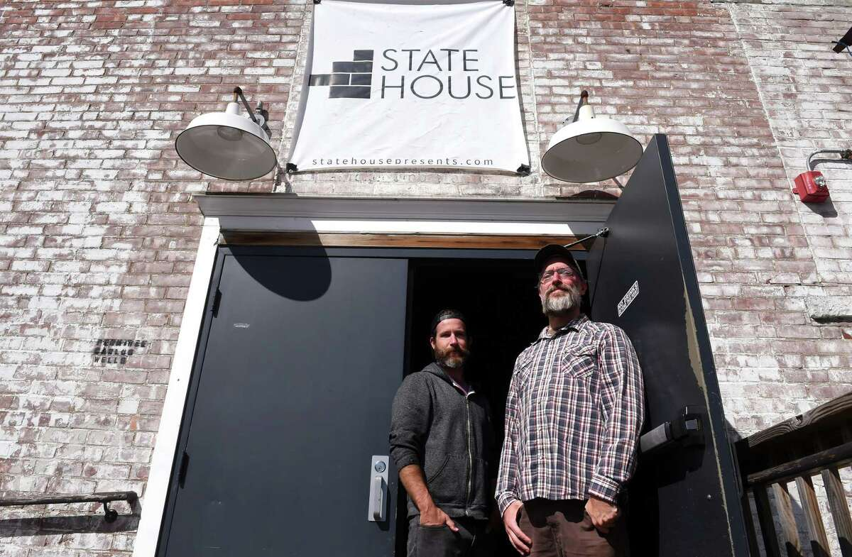 State House co-owners Slate Ballard (left) and Carlos Wells are photographed at the entrance to their music club in New Haven on September 29, 2021 which will reopen on Friday.