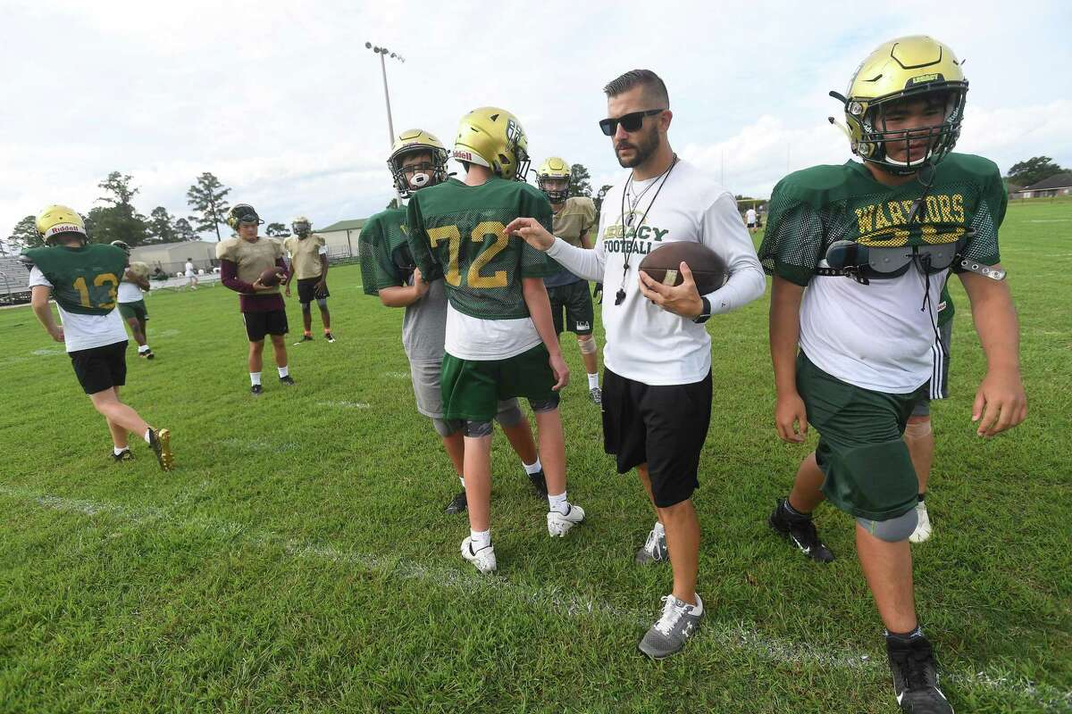 Head cooach Mitchell Stephens directs placyers as Legacy Christian Academy's football team practices and continue to adjust to becoming a 6-man format. Photo made Wednesday, September 29, 2021 Kim Brent/The Enterprise