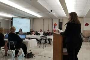 Christina Jacquin of Schowalter and Jabouri P.C. presents the 2020-2021 audit to the board.