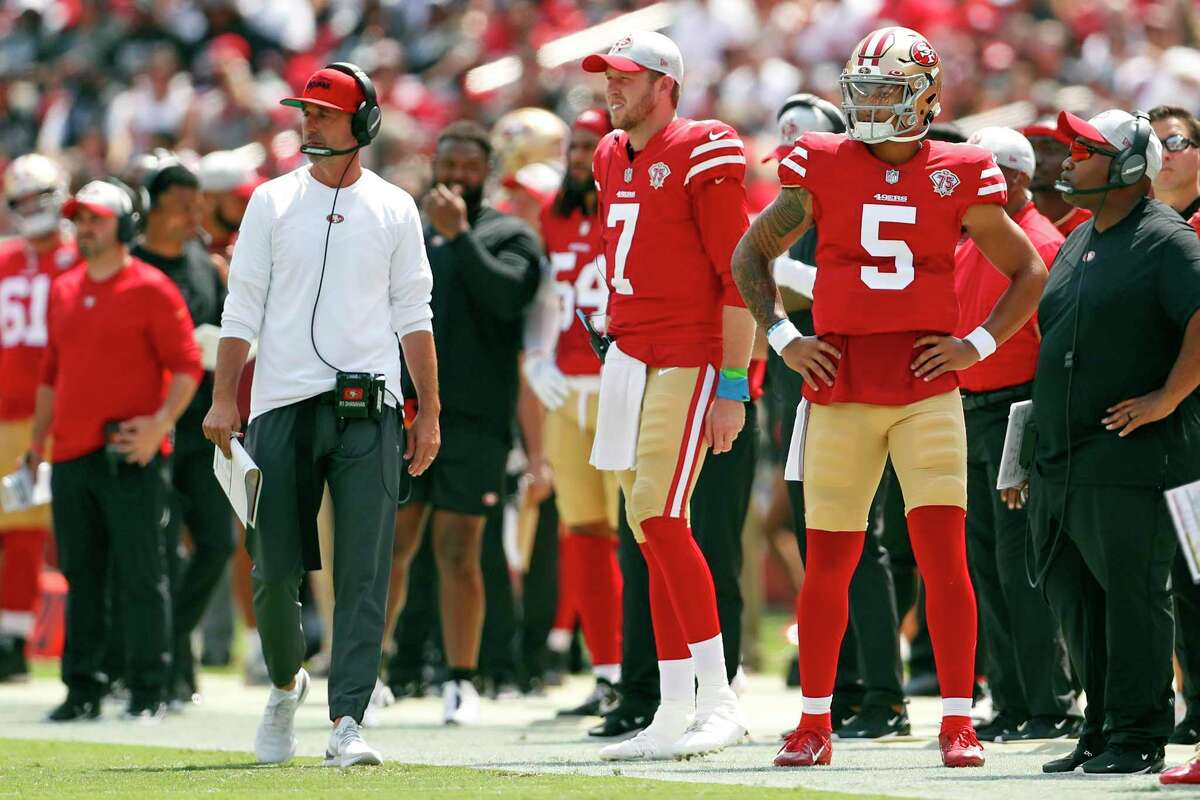San Francisco 49ers' head coach Kyle Shanahan, Nate Sudfeld and Trey Lance watch action in 1st quarter of 34-10 win over Las Vegas Raiders during NFL preseason game at Levi's Stadium in Santa Clara, Calif., on Sunday, August 29, 2021.