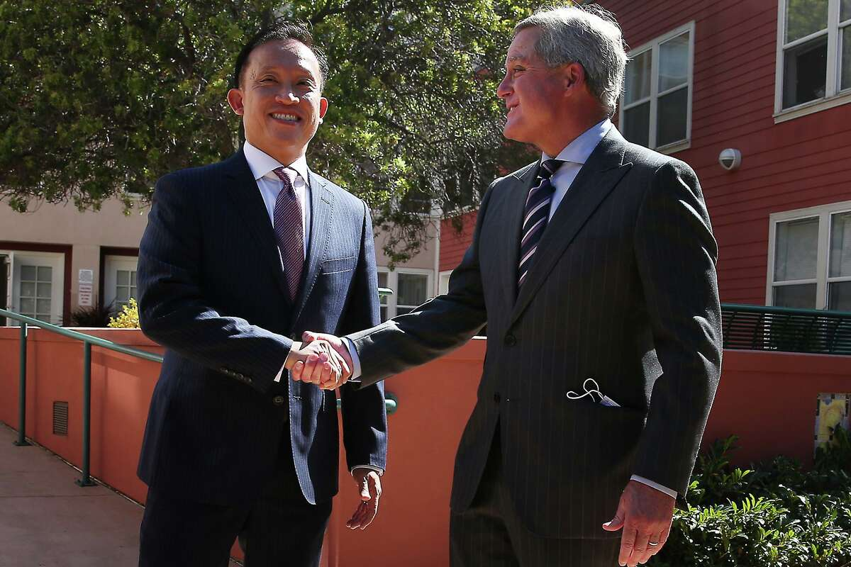 Assembly Member David Chiu (left) shakes hands with City Attorney Dennis Herrera after being named the new city attorney.