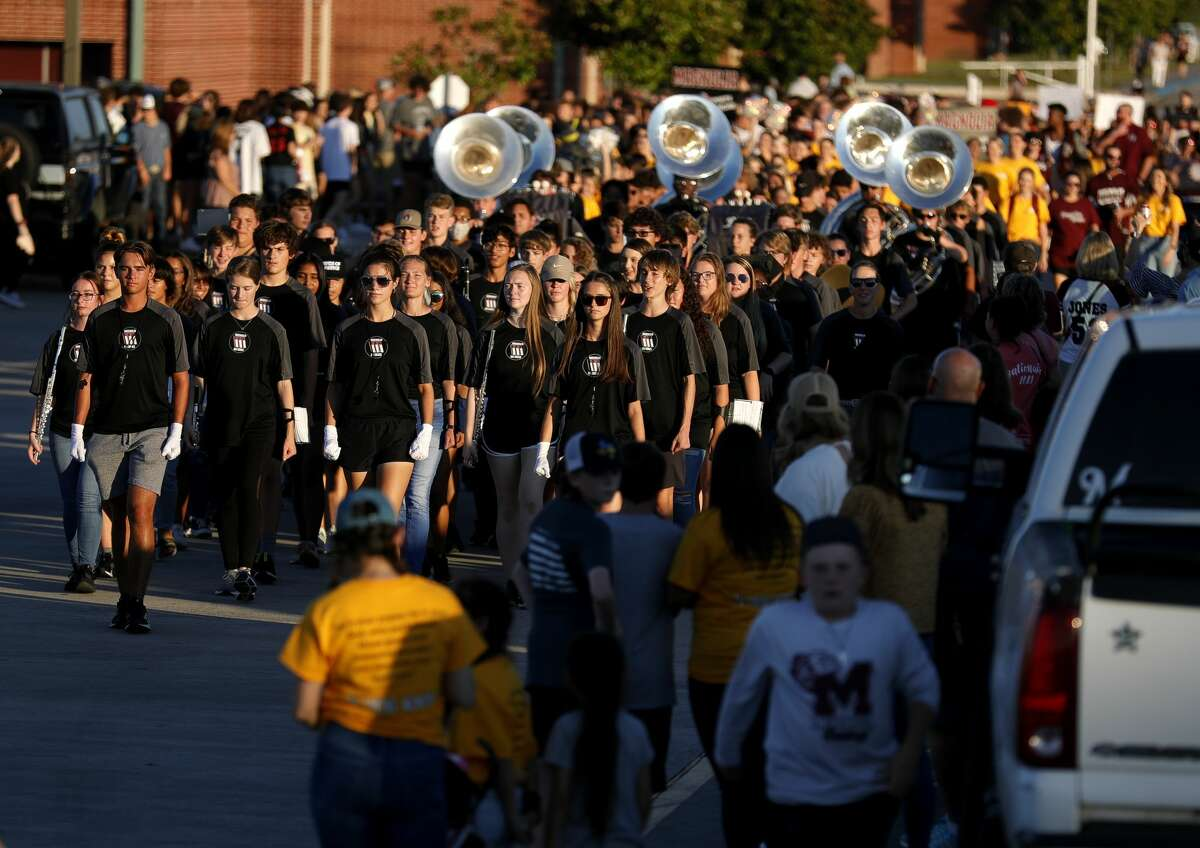 Magnolia High School band members march toward the school's bonfire site as students and organizations celebrate homecoming with a bonfire and pep rally Wednesday, Sept. 29, 2021, in Magnolia. The bulldogs will host Caney Creek Friday for their homecoming game.