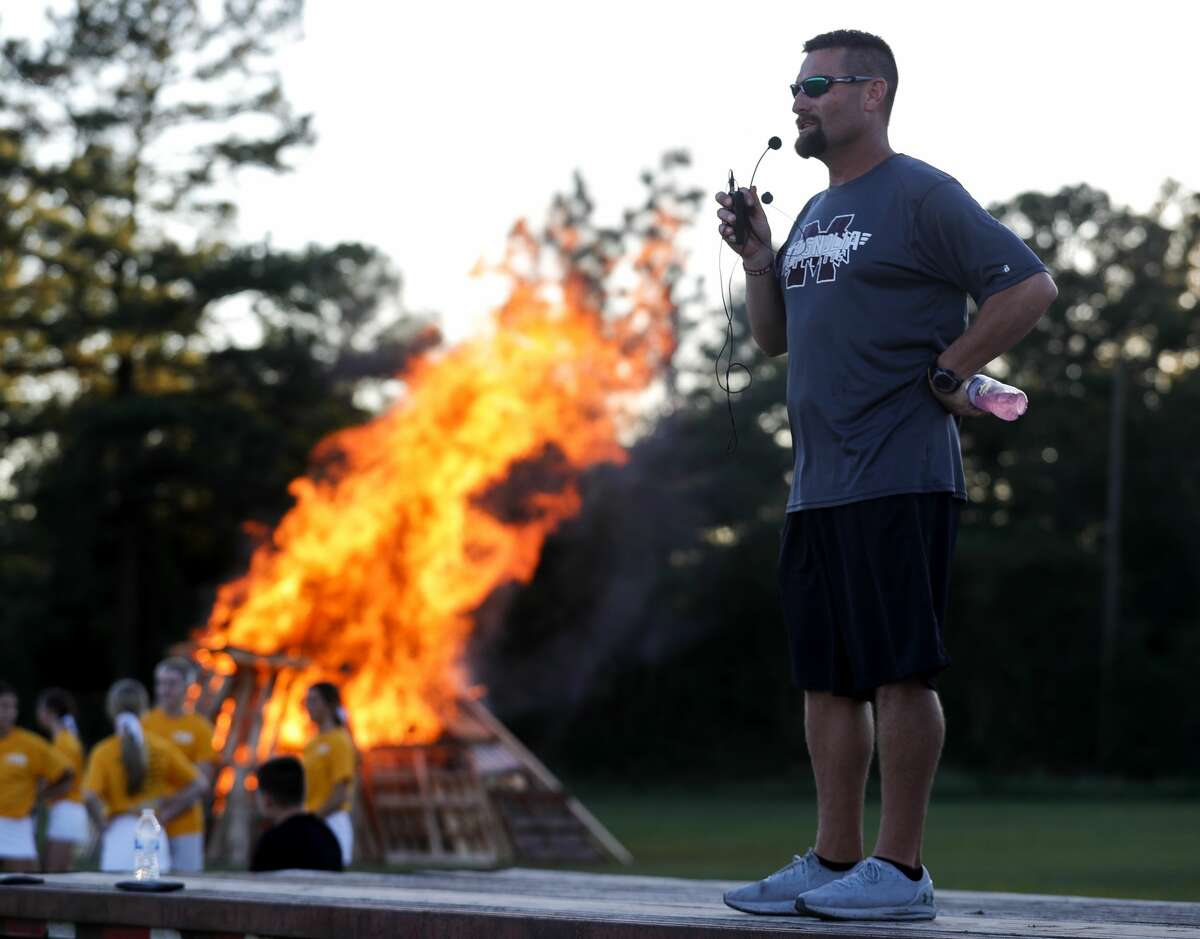 Magnolia head football coach Craig Martin speaks as students and organizations celebrate homecoming with a bonfire and pep rally, Wednesday, Sept. 29, 2021, in Magnolia. The bulldogs will host Caney Creek Friday for their homecoming game.