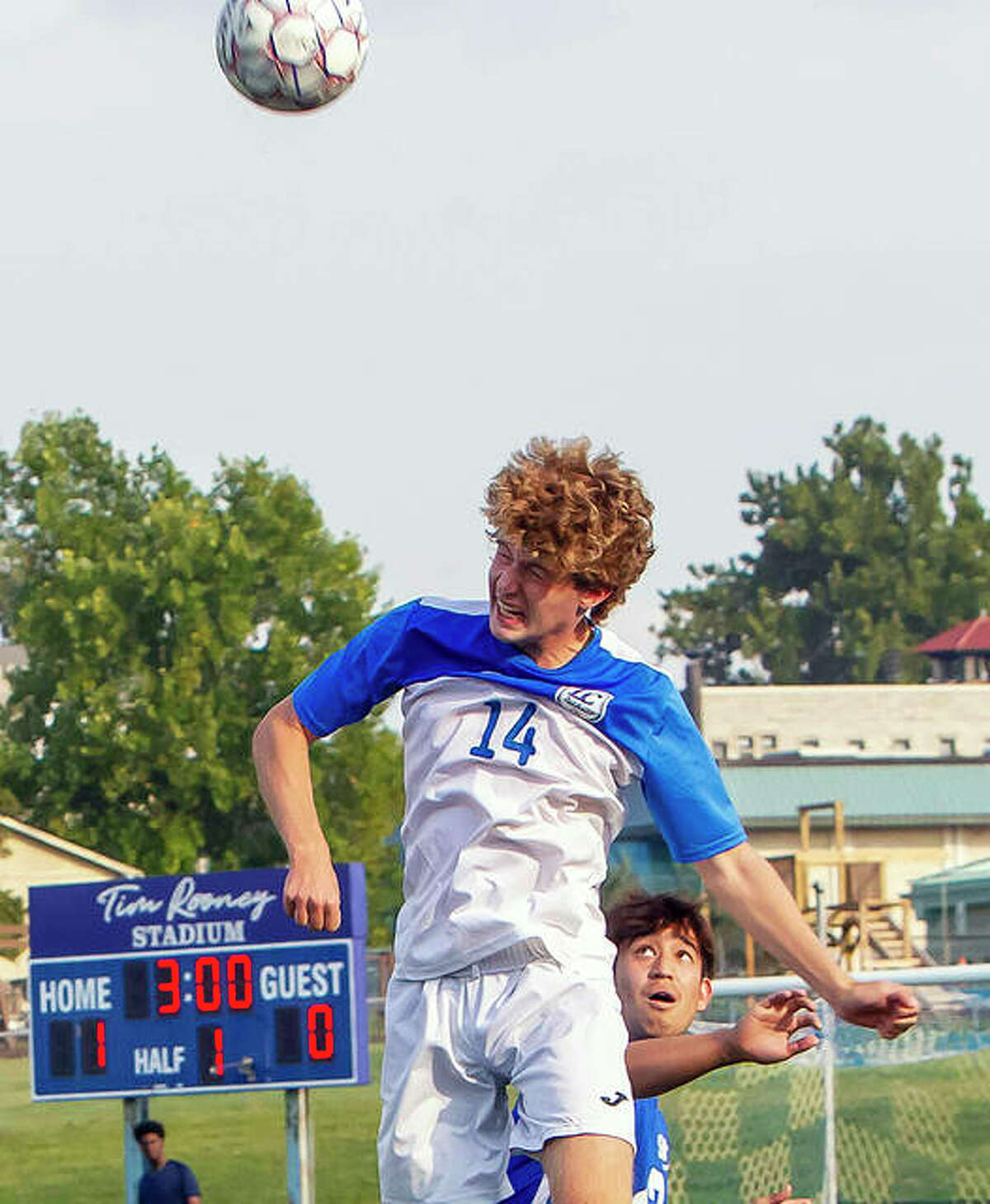 LCCC's Brayden Decker (14), a sophomore from Alton, grits his teeth as he heads the ball away from a Southwestern Illinois College player Wednesday at Rooney Stadium. LCCC won the game 3-0.