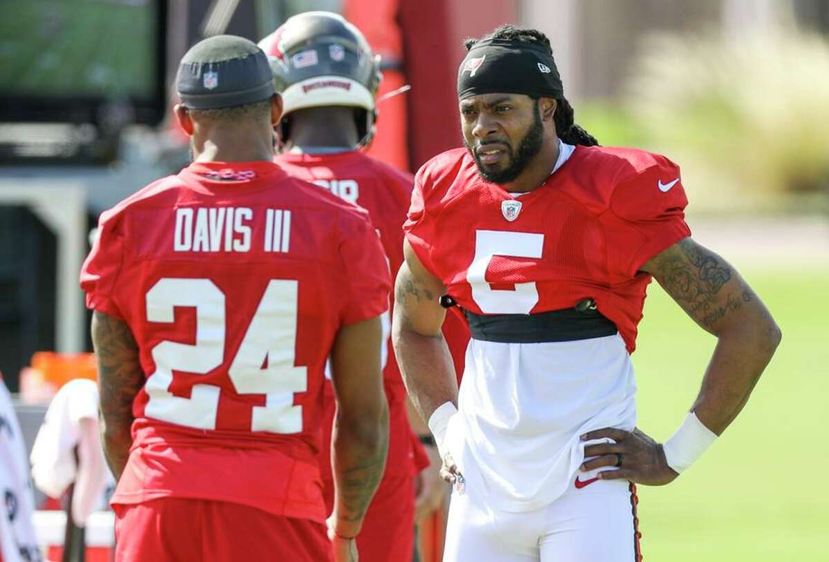 Cornerback Richard Sherman talks with his new teammate Carlton Davis III during his first practice with the Buccaneers.