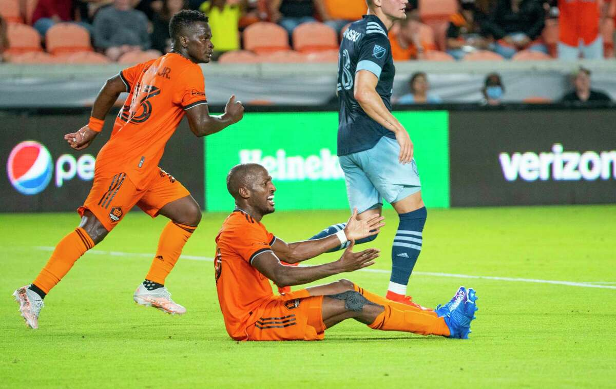 Houston Dynamo midfielder Fafa Picault (10) reacts as he fails to have a foul called as he trips bringing the ball into the box during the first half of a MLS soccer match between the Houston Dynamo and Vancouver Whitecaps on Wednesday, Sept. 29, 2021, at BBVA Stadium in Houston.