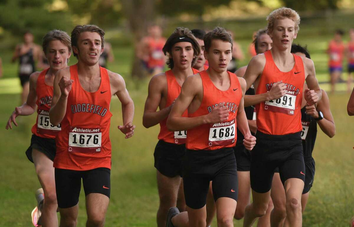 The Ridgefield Tigers run in a pack during a boys cross country meet in New Canaan's Waveny Park on Wednesday, Sept. 29, 2021.