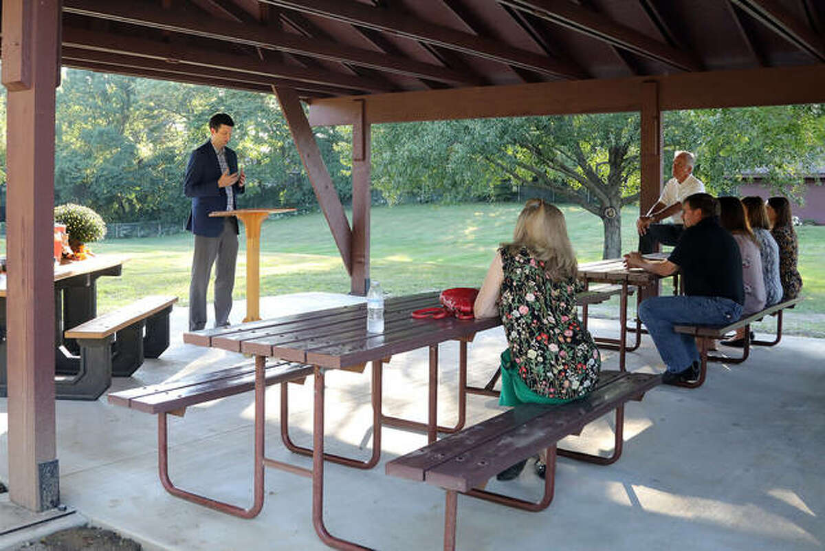 Edwardsville Township Supervisor, Kevin Hall, gave his remarks Tuesday during a dedication ceremony at pavilion #6 in Township Park. The pavilion has been dedicated to Sally Speciale, who was a frequent visitor.
