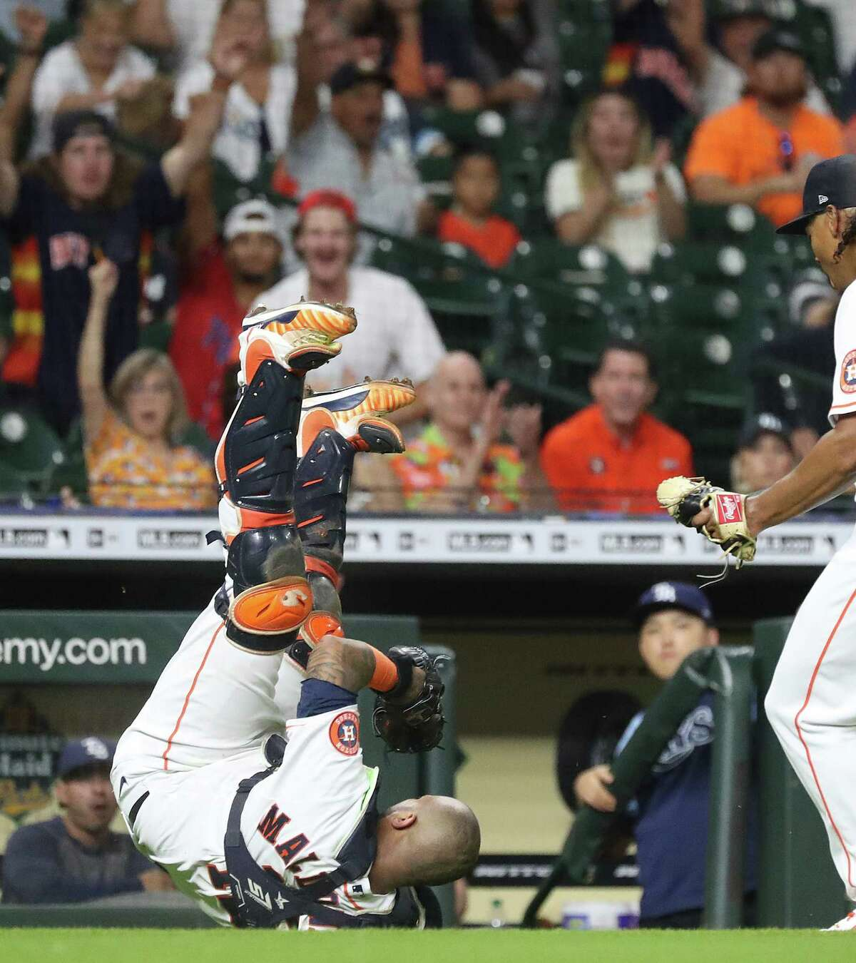 Houston Astros catcher Martin Maldonado (15) catches Tampa Bay Rays Brett Phillips' bunt pop out in front of the Rays dugout during the fourth inning of an MLB baseball game at Minute Maid Park, Wednesday, September 29, 2021, in Houston.