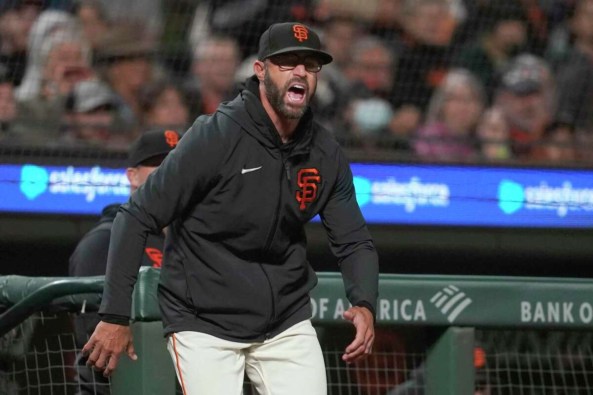 San Francisco Giants manager Gabe Kapler reacts toward home plate umpire Dan Iassogna after LaMonte Wade Jr. was called out on strikes against the Arizona Diamondbacks during the fourth inning of a baseball game in San Francisco, Wednesday, Sept. 29, 2021. (AP Photo/Jeff Chiu)