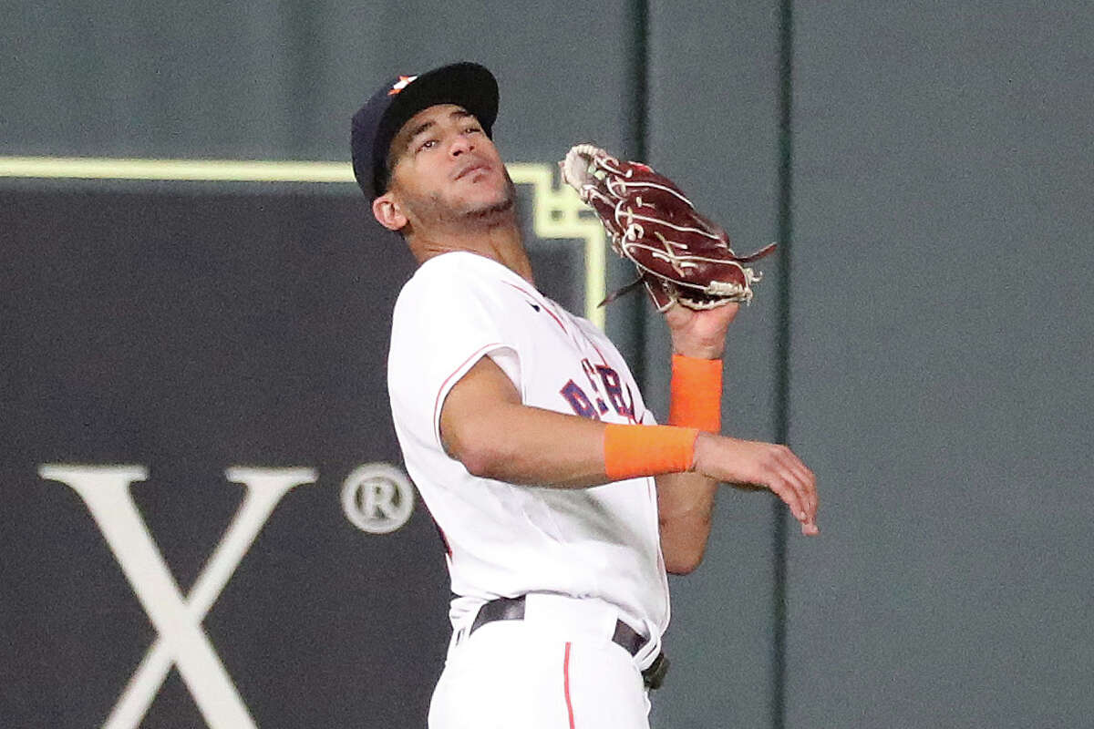 Jose Siri caught this fly ball but missed another during Wednesday's game that led to three unearned runs in the Astros' 7-0 loss to the Rays.