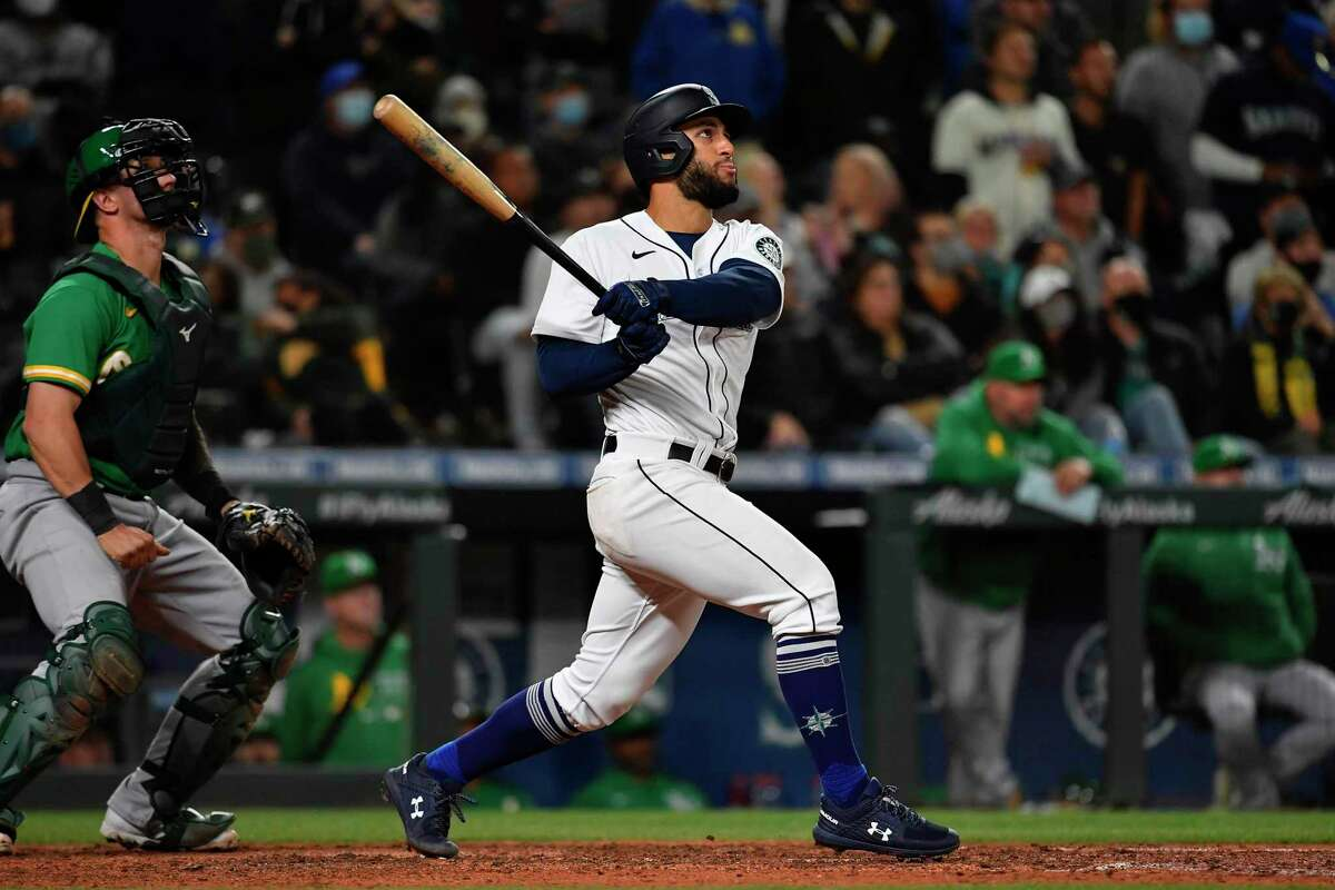 SEATTLE, WASHINGTON - SEPTEMBER 29: Abraham Toro #13 of the Seattle Mariners hits a solo home run during the eighth inning against the Oakland Athletics at T-Mobile Park on September 29, 2021 in Seattle, Washington. (Photo by Alika Jenner/Getty Images)