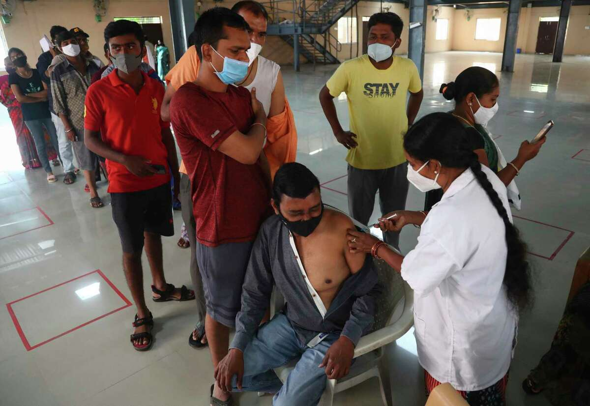 A health worker administers the Covishield vaccine for COVID-19 in Hyderabad, India on Sept. 24.