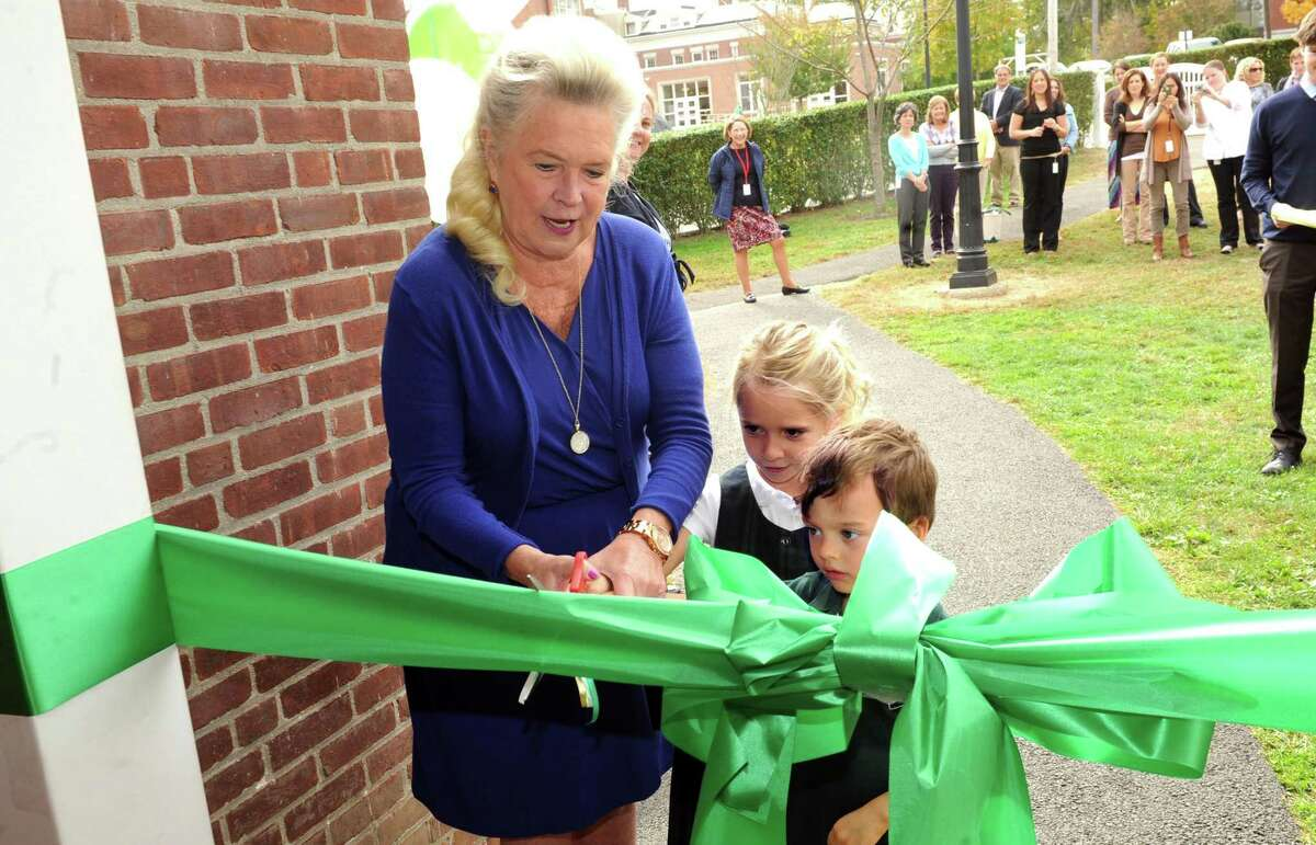 Head of School Pamela Juan Hayes, Olivia Franco, 4, of Armonk, N.Y., and Danny Castagna, 3, of Norwalk, cut the ribbon for the Barat Center for Early Childhood Education at Convent of the Sacred Heart , in Greenwich, Conn., Wednesday Oct. 16, 2013.