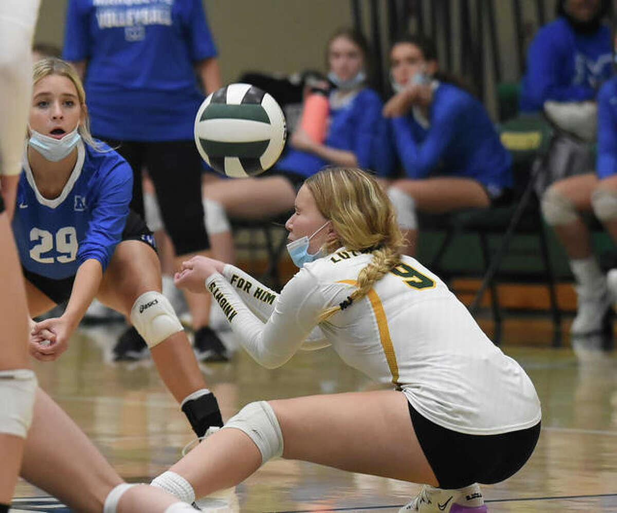 Metro-East Lutheran's Grace Hopp tries to save from underneath the net late in the second set.